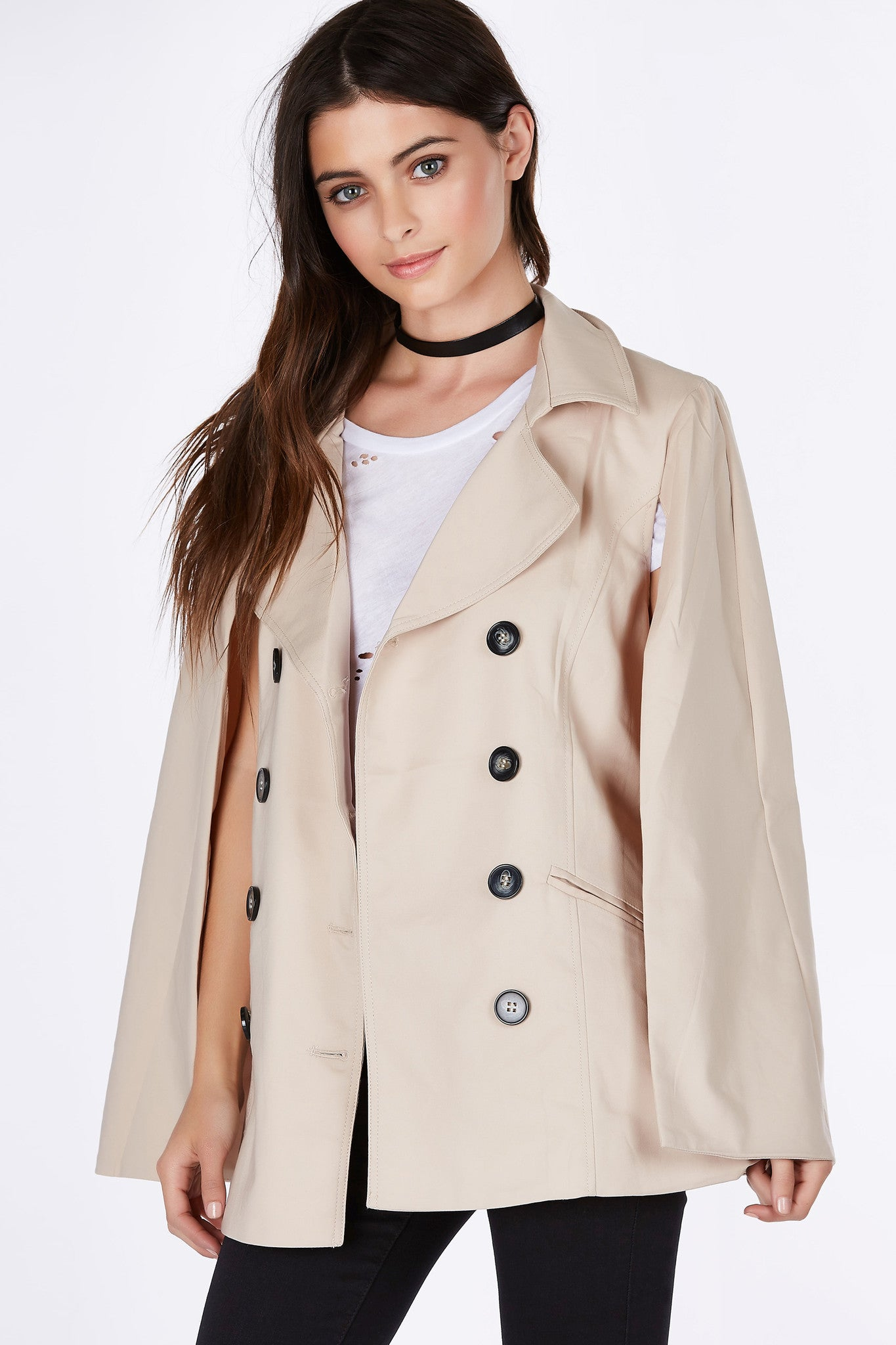 A classic trench with a stylish twist. Cape design brings a preppy vibe to your look. Clean collars with buttons in front for closure. Faux pockets for added detail, great to style with a white tee and skinny denims.
