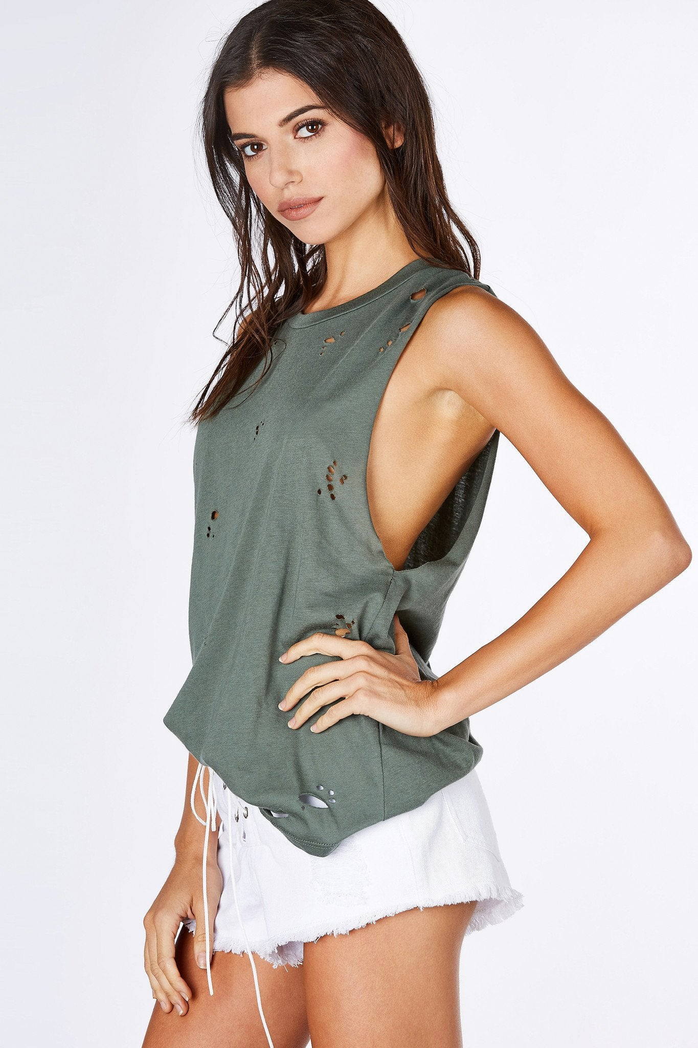 A basic muscle tank is everyone's necessity for the heat. This awesome top features dope distressing throughout the front, perfect for a steezy street style outfit! Pair with a sports bra and denim cut offs for a relaxed but trendy outfit.