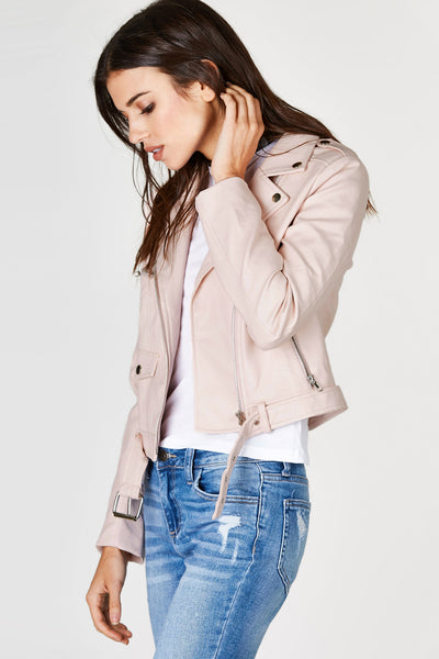 Every girl needs a cool faux leather jacket in their wardrobe. This awesome moto jacket is no exception when it comes to Fall and Winter essentials. Smooth faux leather exterior with a slightly cropped hem. Fully lined and ready to keep you trendy and warm all day and night!