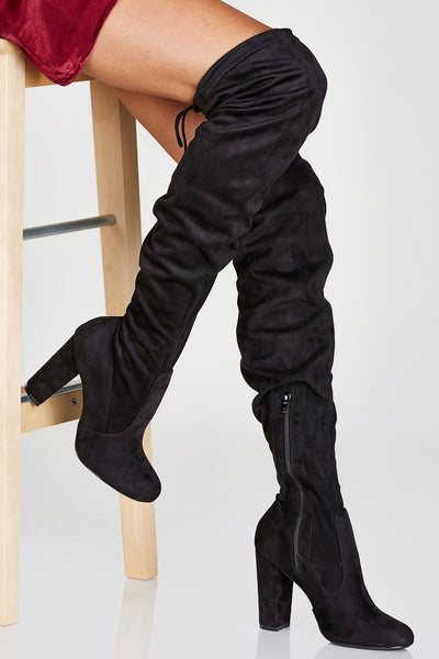 An incredible pair of thigh high boots with a chic suede finish. Slim, stretchy fit with inner zip closure. Ties at top for closure and for added detail. Chunky block heels makes it perfect for a stylish but comfortable going out look!