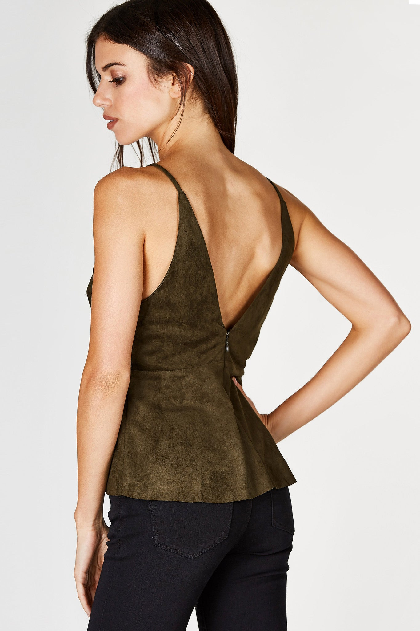 It's time to embrace the upcoming Season's trend. This gorgeous suede finish top is perfect for a casual daytime look or even a sultry nighttime outfit. Deep V-neckline with classic spaghetti straps. Flared raw hem with a hidden zip closure in the back.