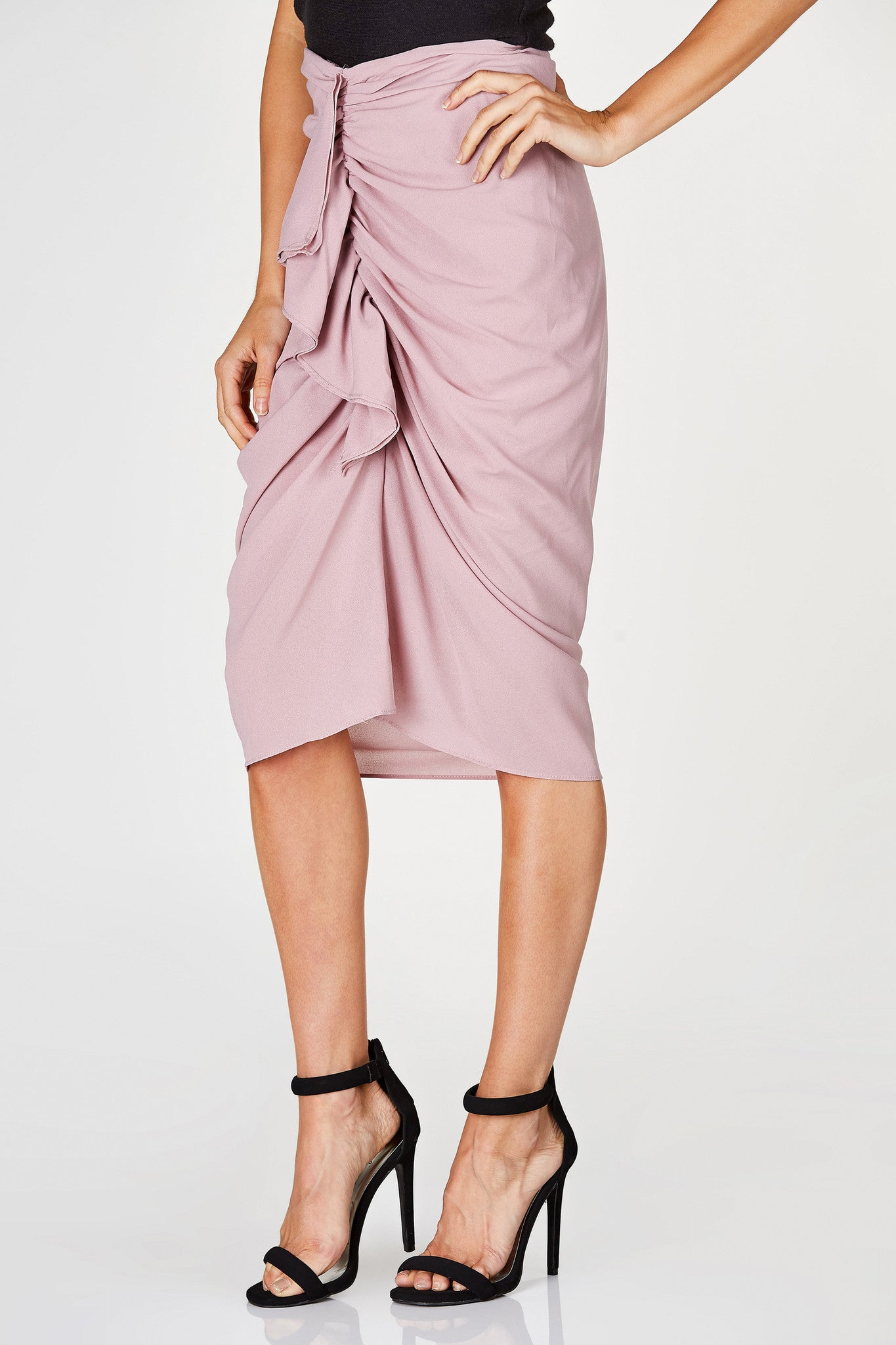 A gorgeous chiffon midi skirt with ruching in front with a ruffled finish. Tapered fit to flatter your curves. Single zip closure in the back with elasticized waistband for comfortable fit. Perfect for special night time events!