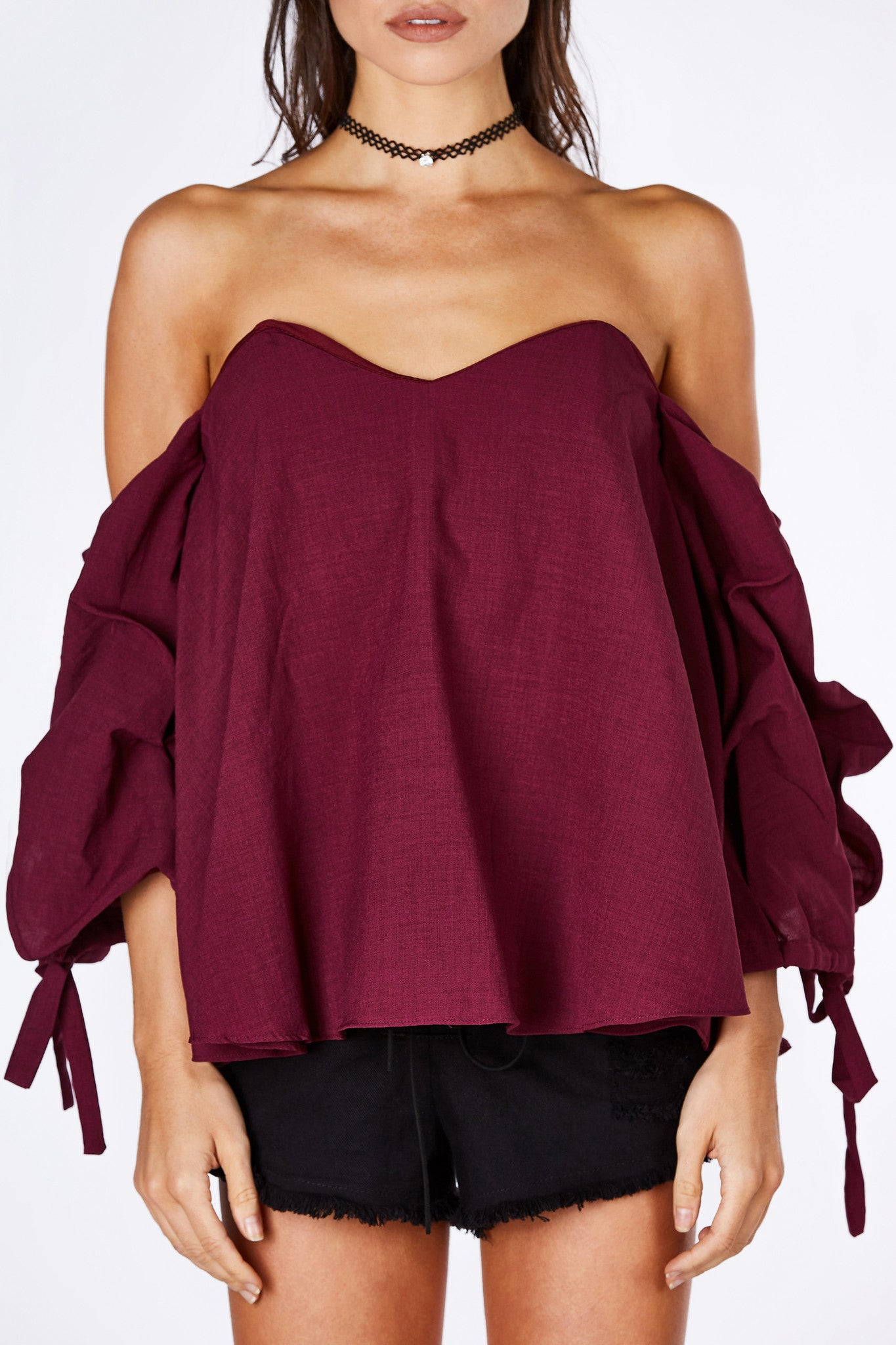 An adorable off shoulder top with a flattering sweet heart neckline. Fun bubbly sleeves with a soft draping effect. Features a tie at each end for added detail. Lined at bust with wiring for structure. Hidden zip closure for a clean finish.