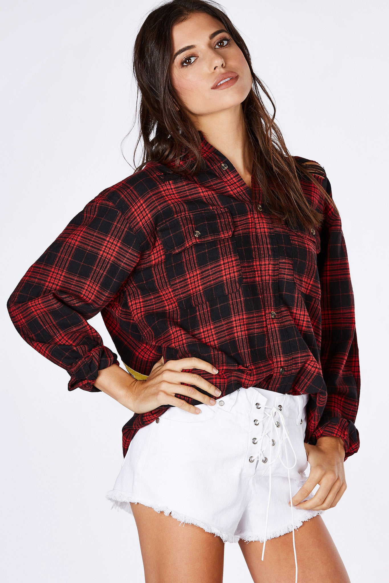 A dope flannel perfect for the upcoming Season. Trendy distressing throughout with classic plaid pattern. Two front pockets with fun graphic in the back for a re-vamped vintage vibe. Style with a bodysuit and shorts underneath with some kick-ass boots!