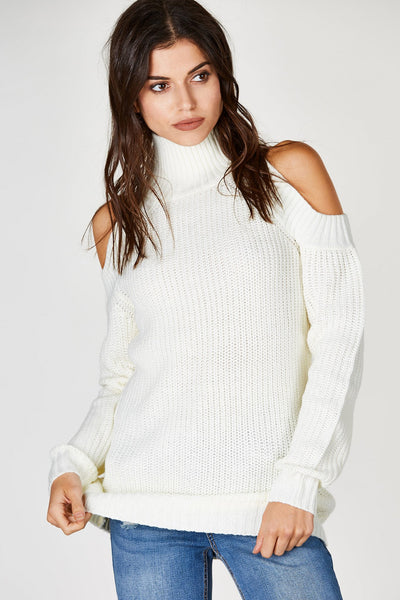 An adorable basic long sleeve sweater with a bit of a modern twist. Chic cold shoulders with a high mock neck for extra coziness. Perfectly knitted with comfortable ribbed hem all around. Pair with your favorite denim skinnies with ankle booties!