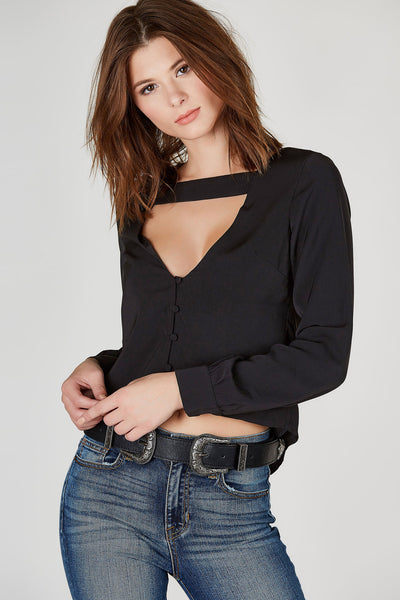 Simple and chic. This lovely long sleeve blouse will definitely bring an upscale vibe to your look. Full lined with a smooth finish. Features a bold band across the front with a deep V-neckline. Fully functional buttons down the front to finish off the look.