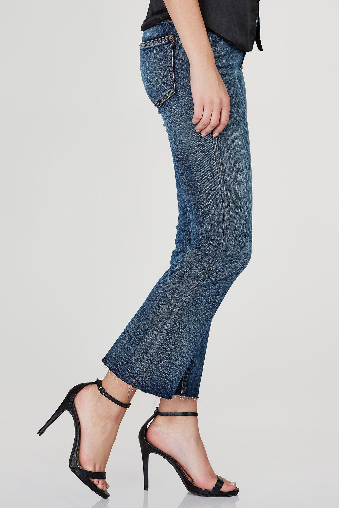The flares are back! These awesome high rise denims feature the covetted raw hem with a trendy flared finish. Perfect medium wash with a comfortable, stretchy fit. Style with a graphic tee tucked in with sneakers for a street-style look!