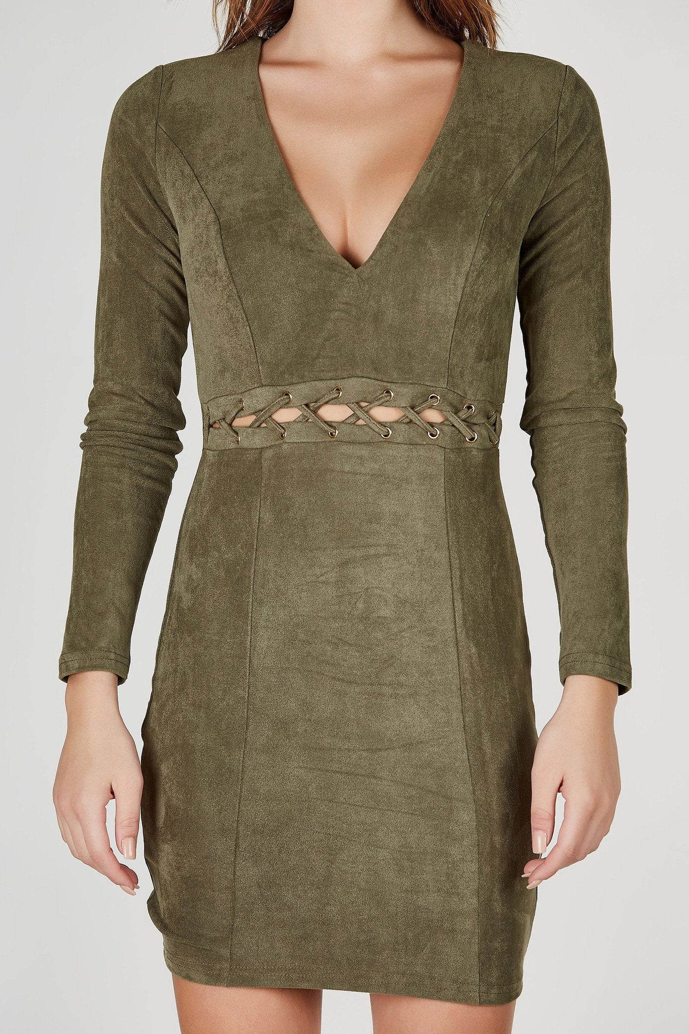 A fashionista's dream- this gorgeous long sleeve mini dress provides the perfect, most flattering fit! Trendy lace up detailing at waist for a chic peek-a-boo effect. Classic V-neckline with the softest suede finish both inside and out!