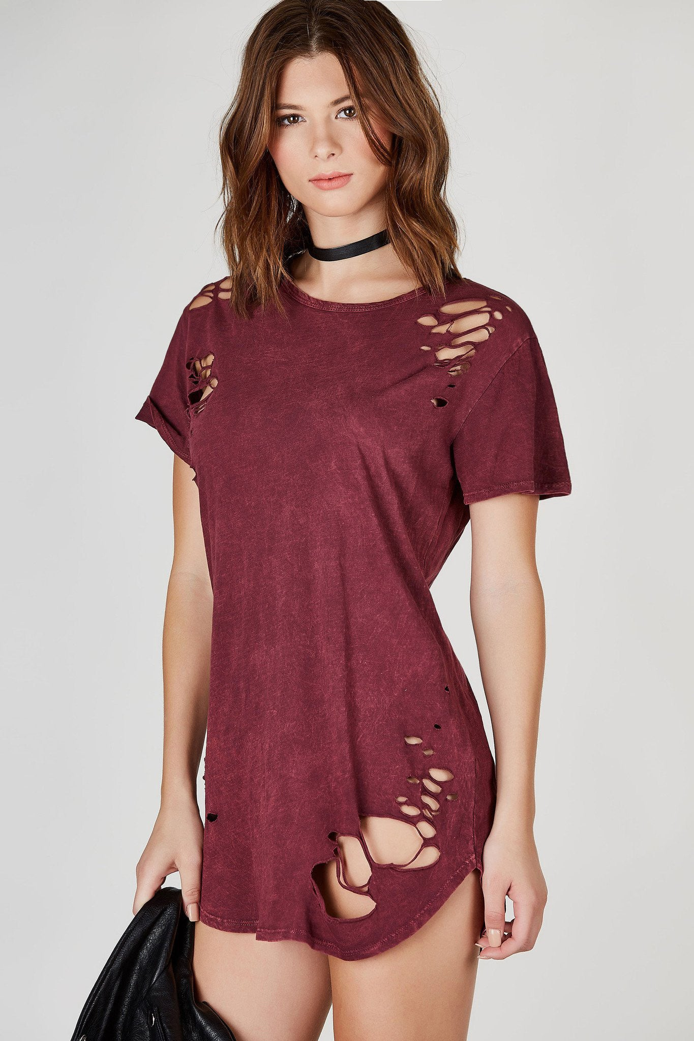 An incredible longline tee wth trendy distressing throughout. Mineral wash with rounded hi-low hem. Perfect to wear as a T-shirt dress on a lazy day. Throw on your favorite sneakers and tie a flannel around your waist for a soft grunge look!