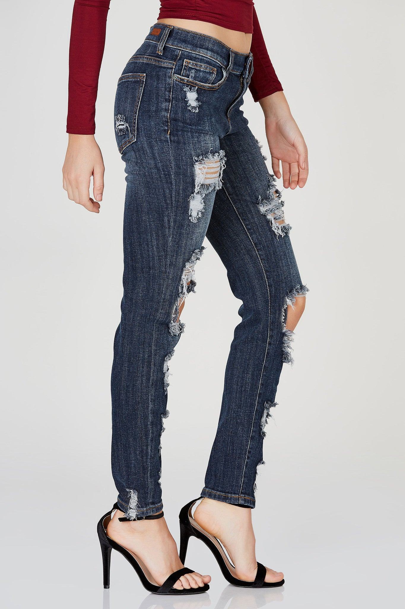 An awesome pair of skinny jeans with some intense distressing throughout for a trendy street-style vibe. Classic five pocket design with slight fading for a vintagesque finish.