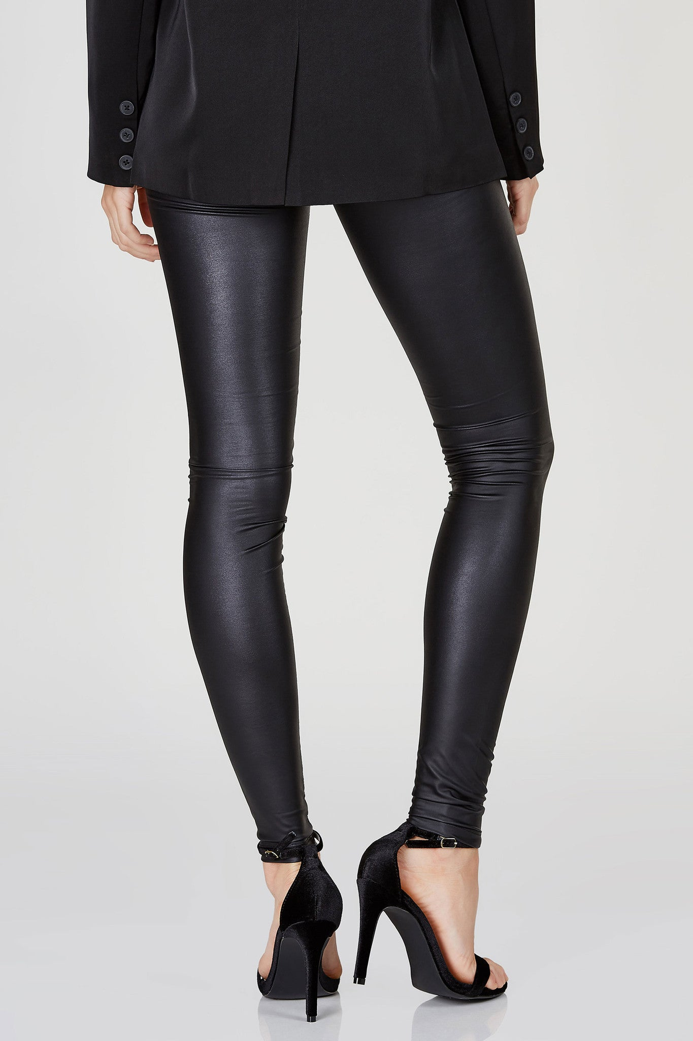 Slim fit and extra sleek. This simple design leggings are anything but boring! Smooth faux leather finish makes it perfect for a night out look in comfort! Style with a statement top and heels for a statement outfit!