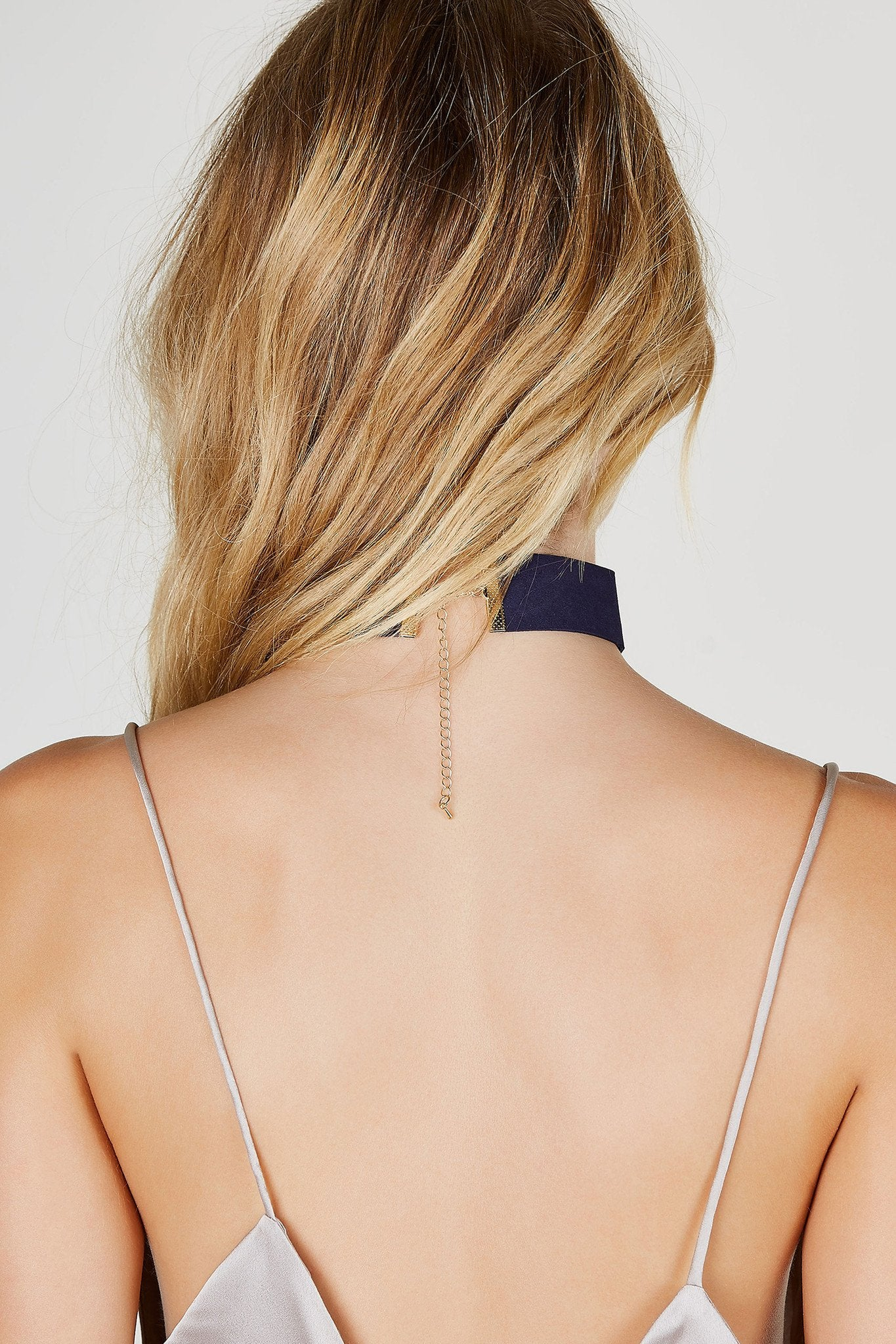 A classic single band choker with a twist. Trendy laced dsign brings added personality to your look. Style with a basic tee and denim cut offs for a casual chic look.
