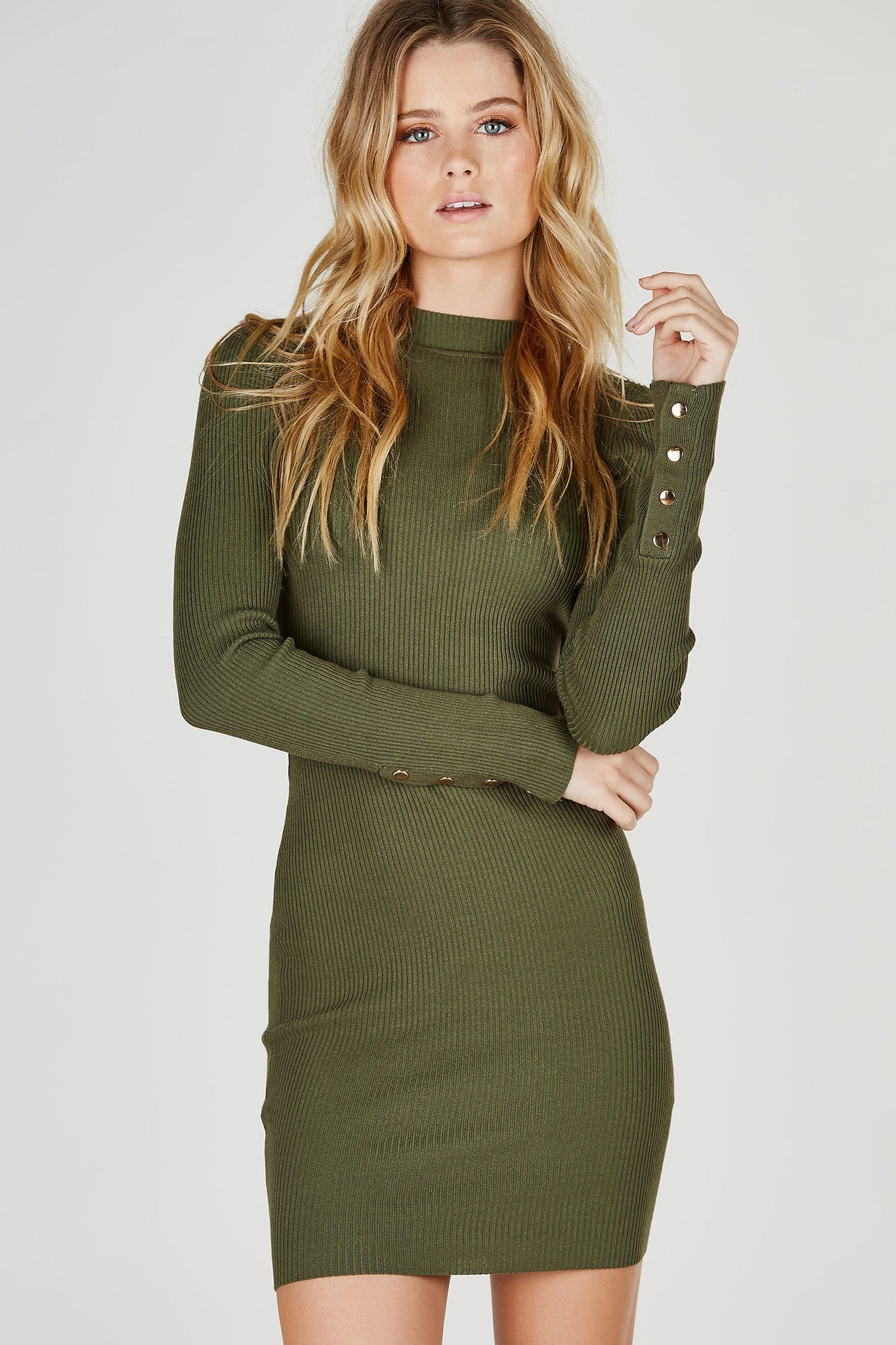 Simple and clean, this long sleeve midi dress is great to many occasions! Ribbed throughout for a stretchy, flattering fit. High neckline with a clean straight hem. Button detailing on each sleeve keeps the look from being boring.