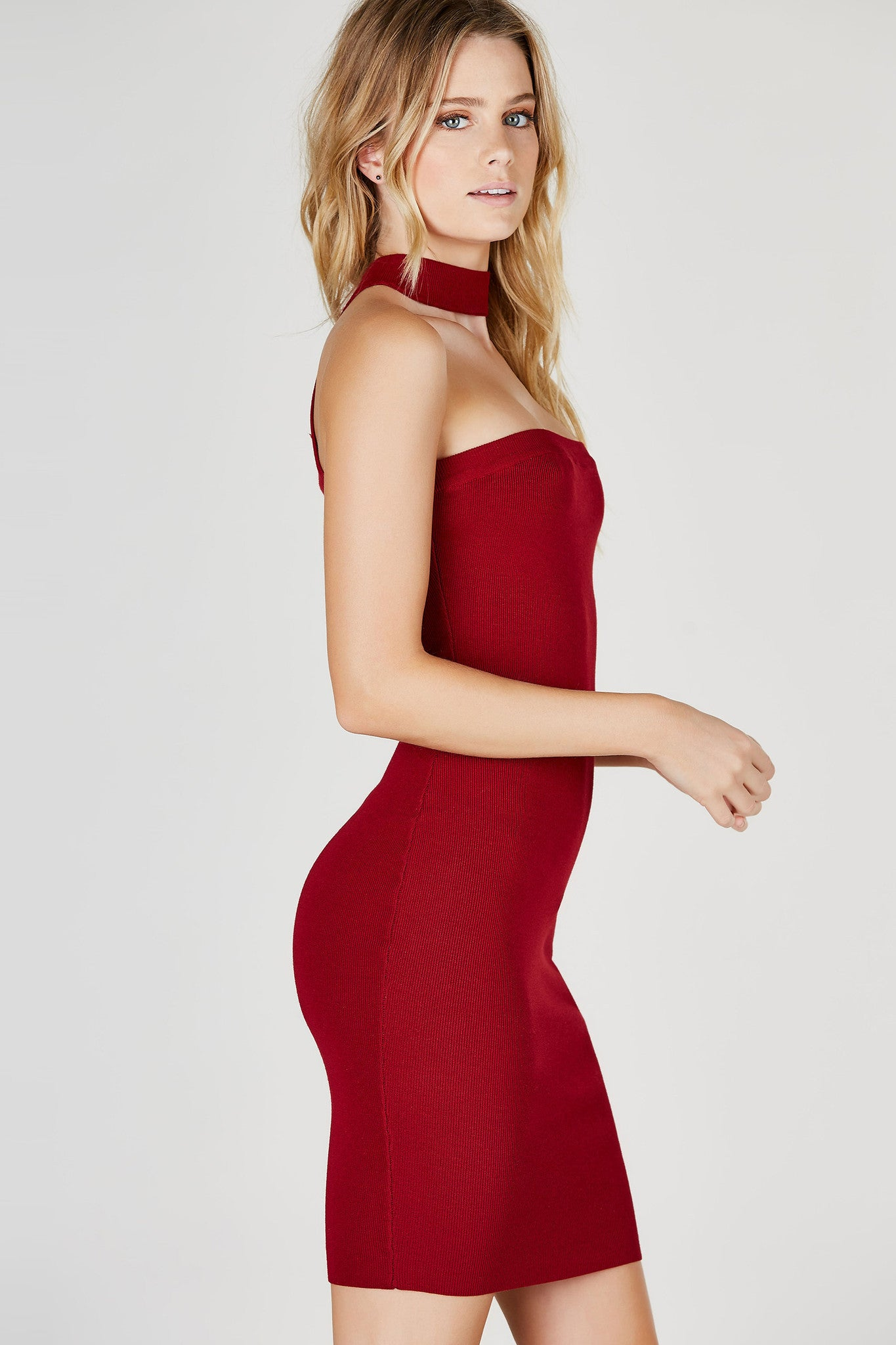 A sexy midi tube dress with a sassy choker neckline attached from the back. Stretchy material provides a flattering body-hugging fit. Great for date nights or special events. Pair with ankle strap pumps and a faux leather jacket!