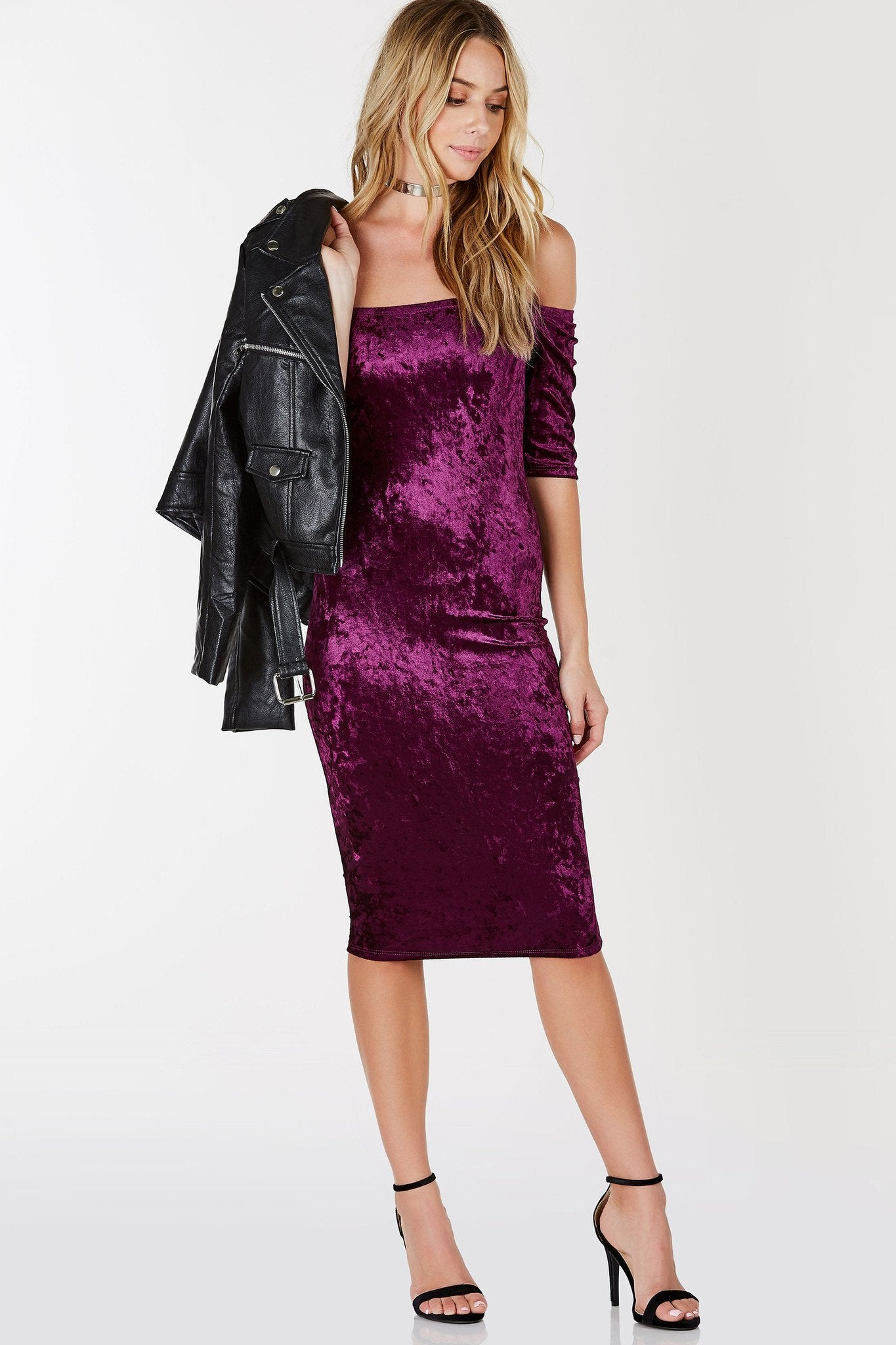 A stunning off shoulder dress with a flattering bodycon fit. Cropped sleeves with straight hem all around. Soft, velvet exterior to elevate your look. Perfect to style with ankle strap pumps and a moto jacket for an evening party.