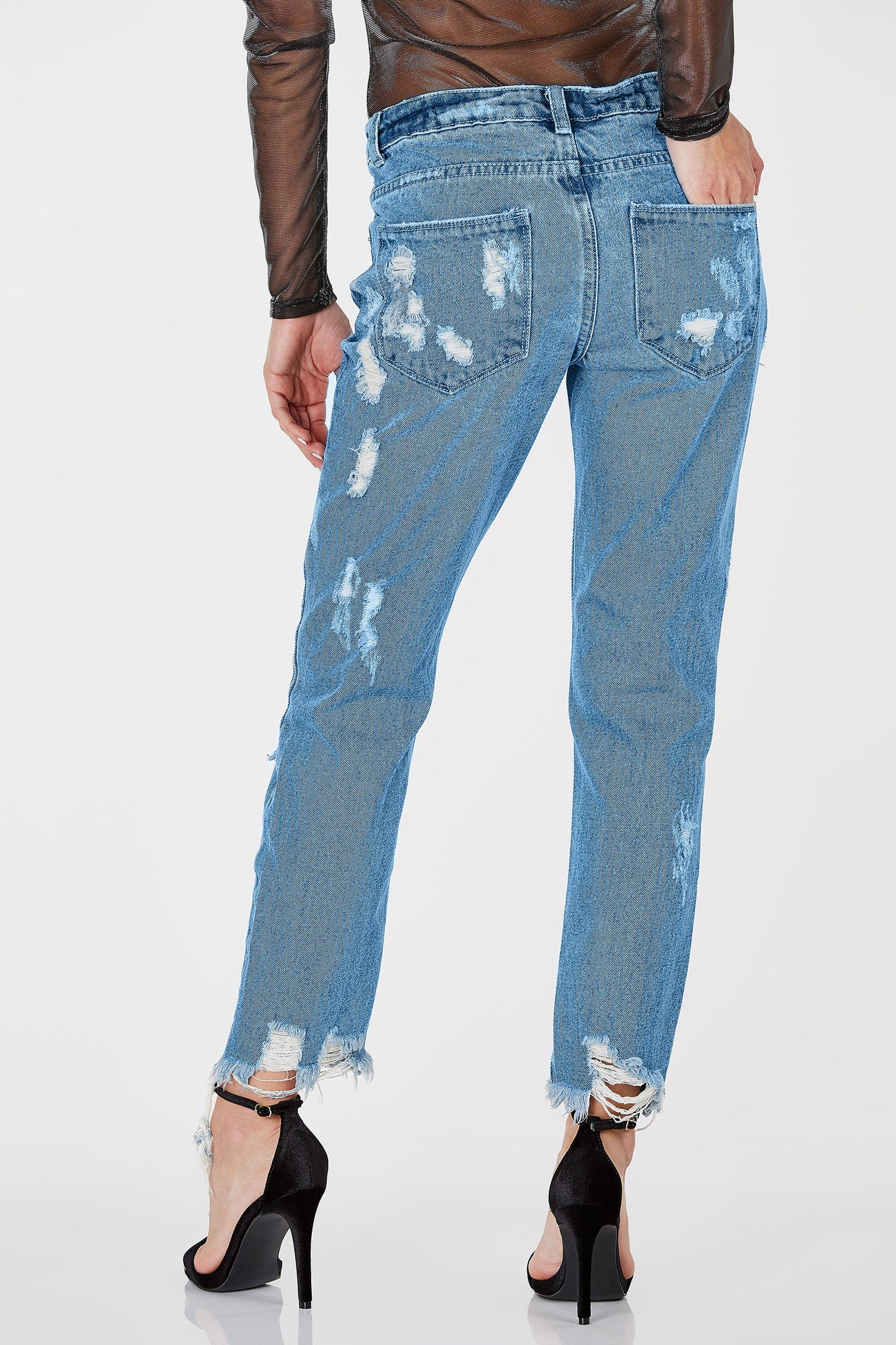 An intensely distressed pair of jeans with a trendy girlfriend fit. Incredible raw, frayed hem brings a stylish, laid back vibe. Perfect wash of sturdy denim, great to pair with a graphic tee and sneakers for a lazy day outfit!