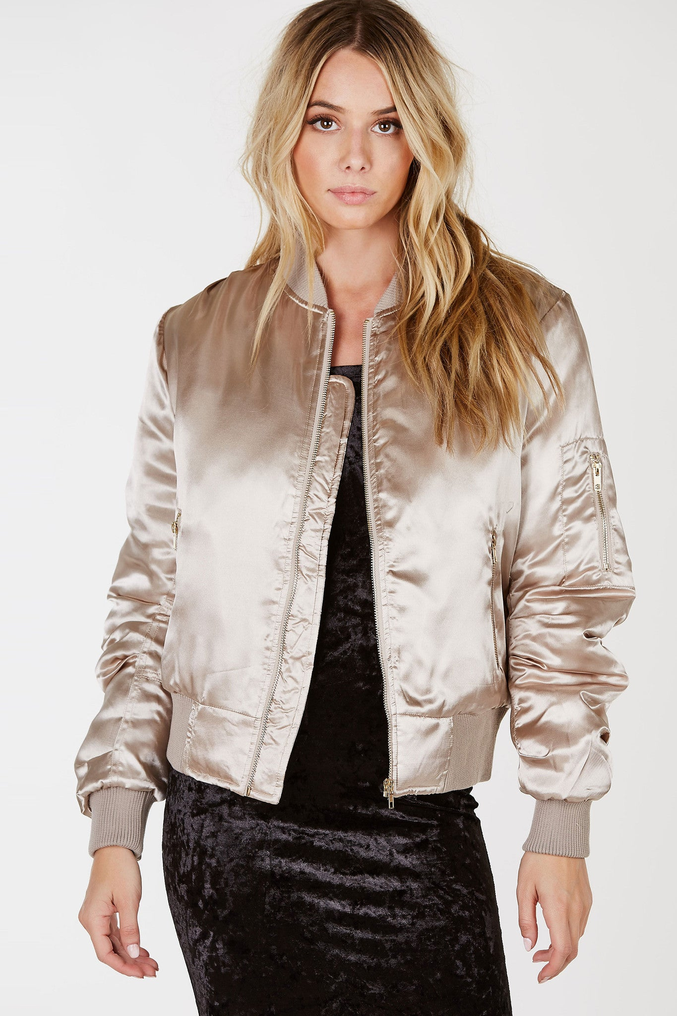 Look and feel extra smooth in this dope padded bomber! Stylish satin finish with a comfortable fit. Classic ribbed hem all around with a single zip closure. Stay cozy and warm in style by throwing it over your basic Fall outfits!