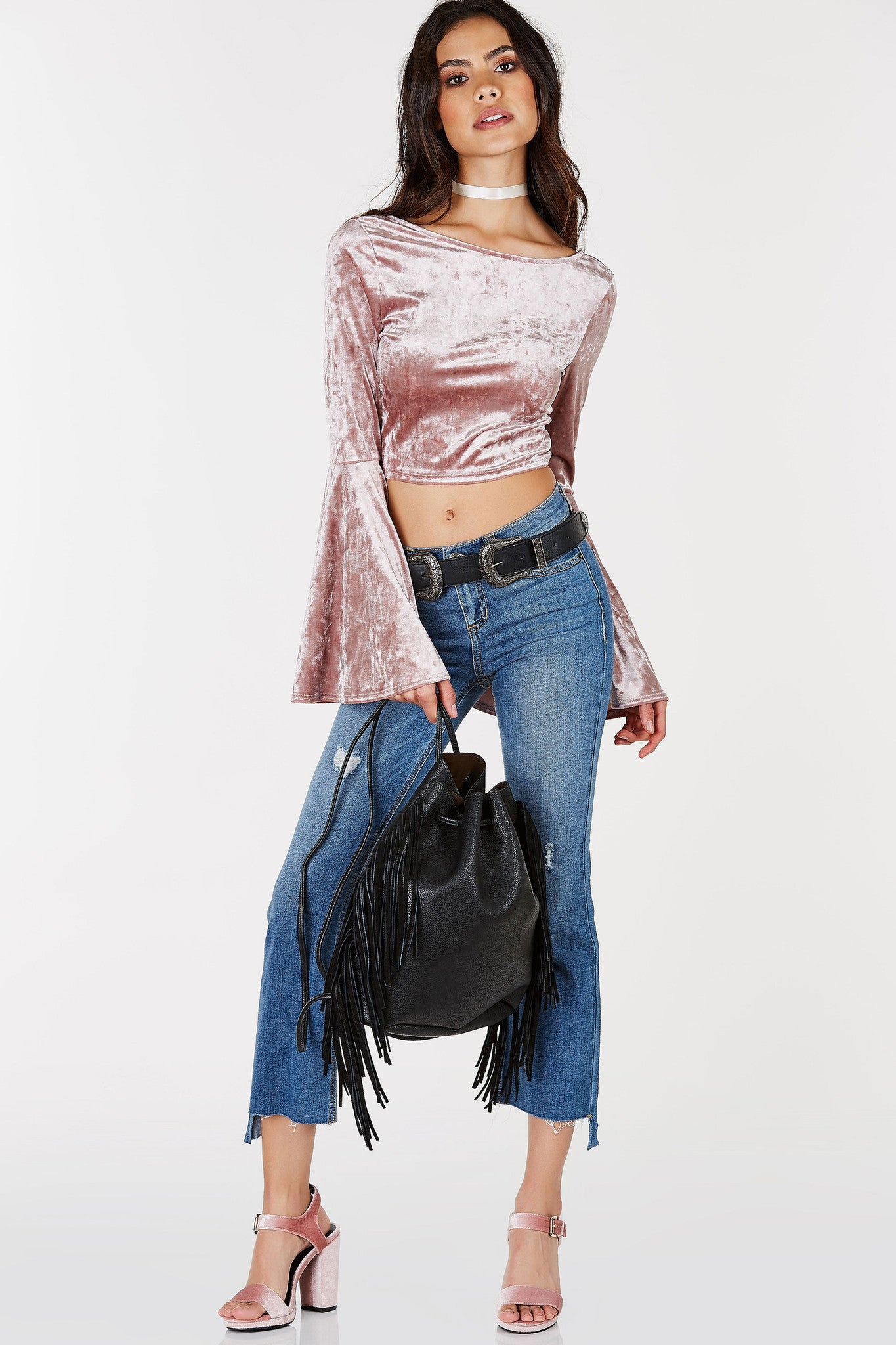 A flirty scoop neck crop top with some groovy long bell sleeves for style. Stunning velvet finish with a lower cut back. Perfect for date nights or parties with a semi-casual vibe. Style with high waist pants and heels!