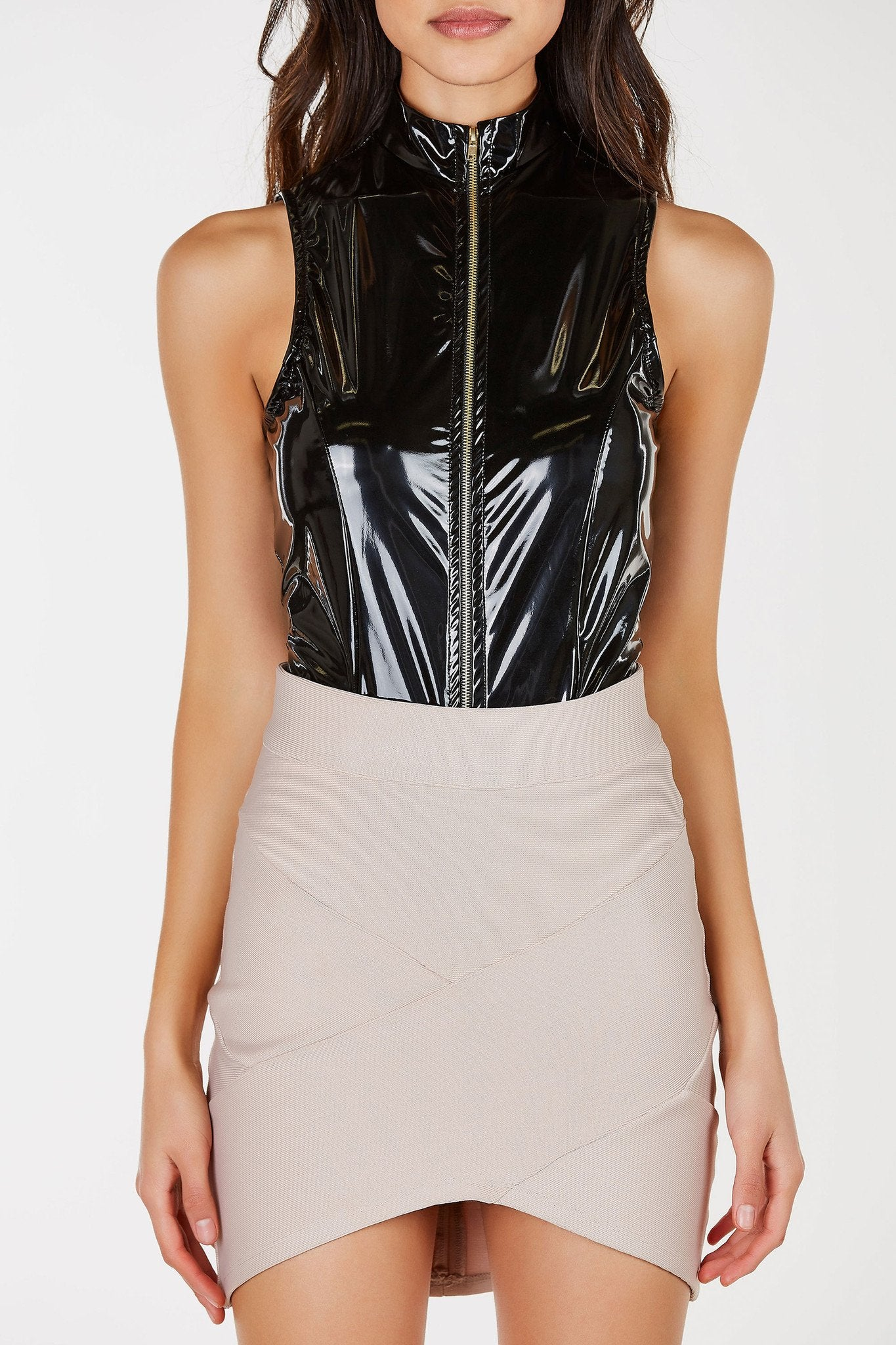 A sexy sleeveless bodysuit with a shiny patent leather finish. Mock neckline with a functional zipper down the front for closure and added detail. Easy snap on button closure with a cheeky cut at bottom.