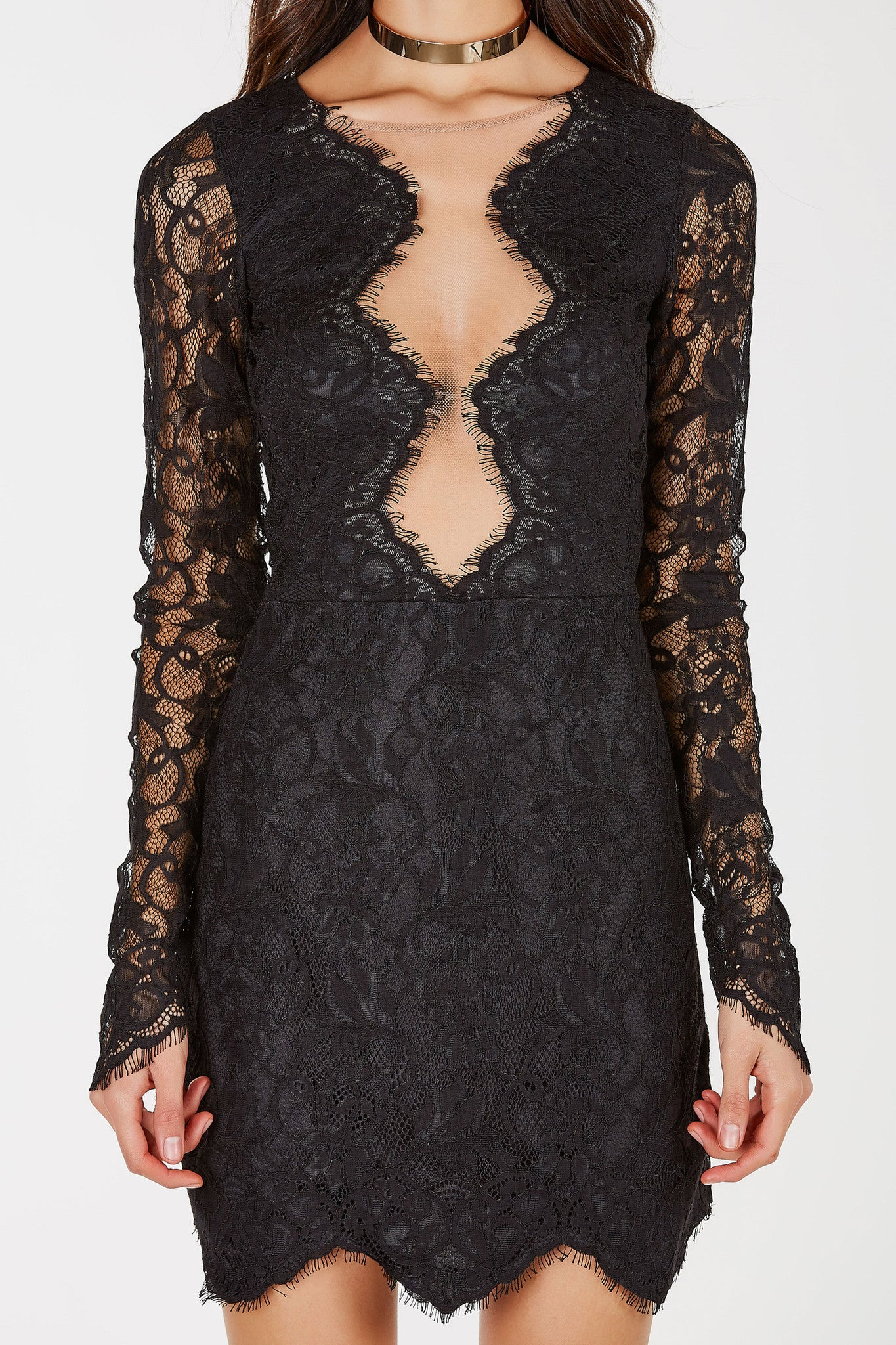 A sophisticated party dress with a gorgeous lace exterior. Contrast mesh panel in front for a sultry vibe. Long fitted sleeves with a peek-a-boo effect. Intricate eyelash trim adds a boost of femininity. The perfect evening dress for special nights out!