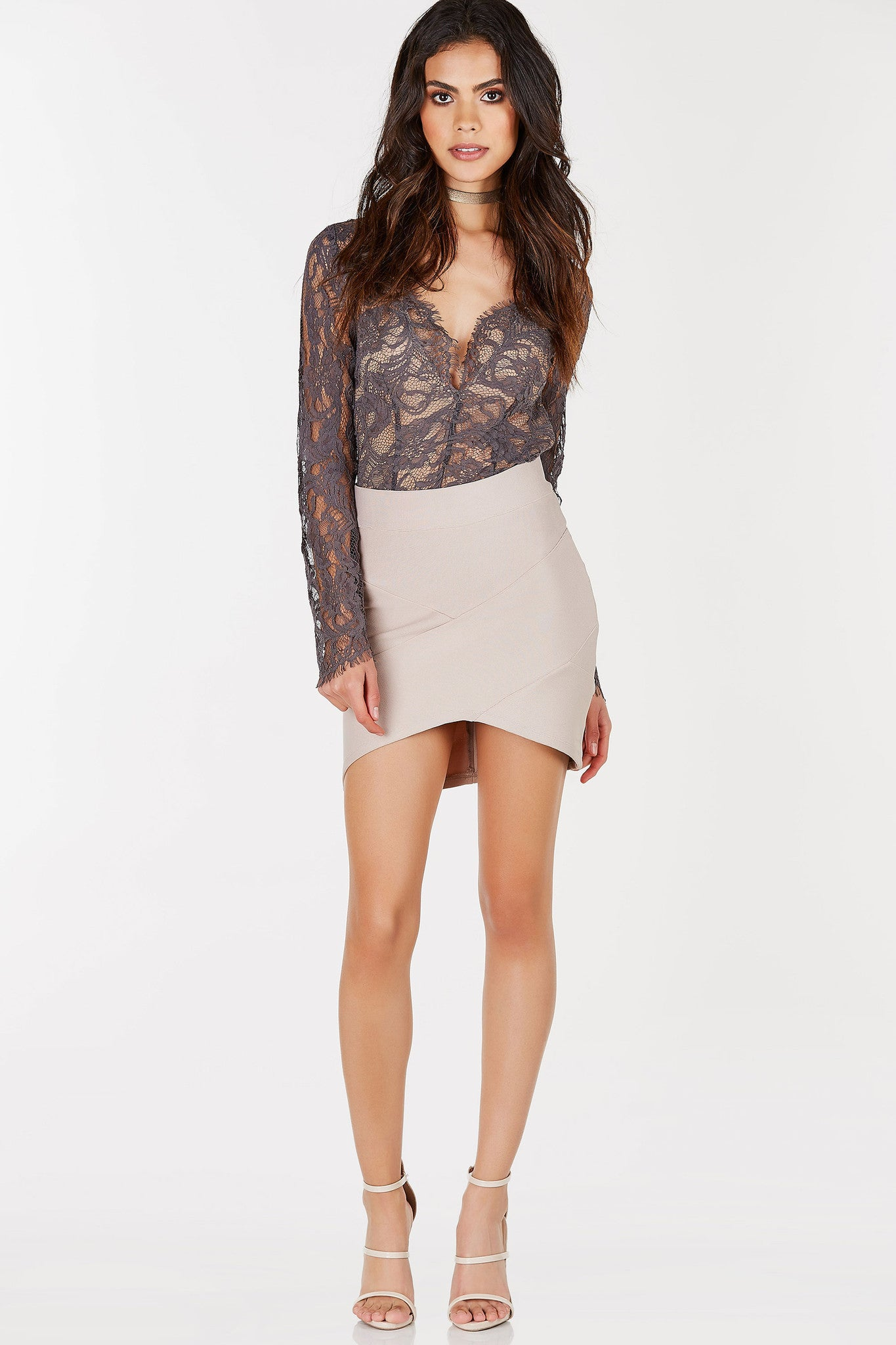 A sultry long sleeve bodysuit with a gorgeous lace exterior, perfect for nighttime looks. Deep V-neckline with eyelash trim all around. Nude lining in front for a chic contrast. Cheeky cut with snap on buttons for closure. Pair with a midi skirt and stilettos for an irresitible party outfit!