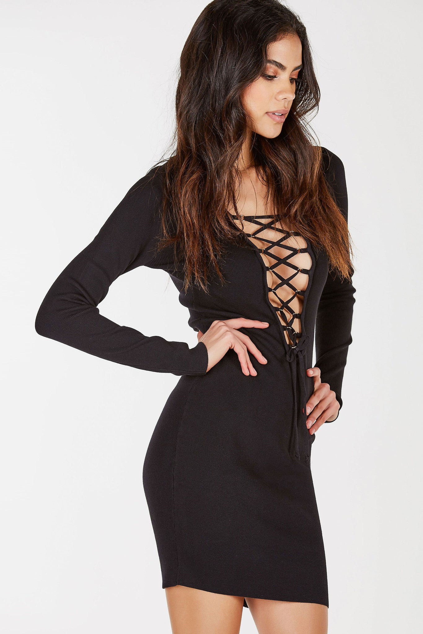 A comfortable ribbed midi dress with a daring deep V-neckline. Trendy lace up design with gold hardware hoops for added detail. Straight hem all around with a slim body-hugging fit. Great for evening parties or special dinner plans.
