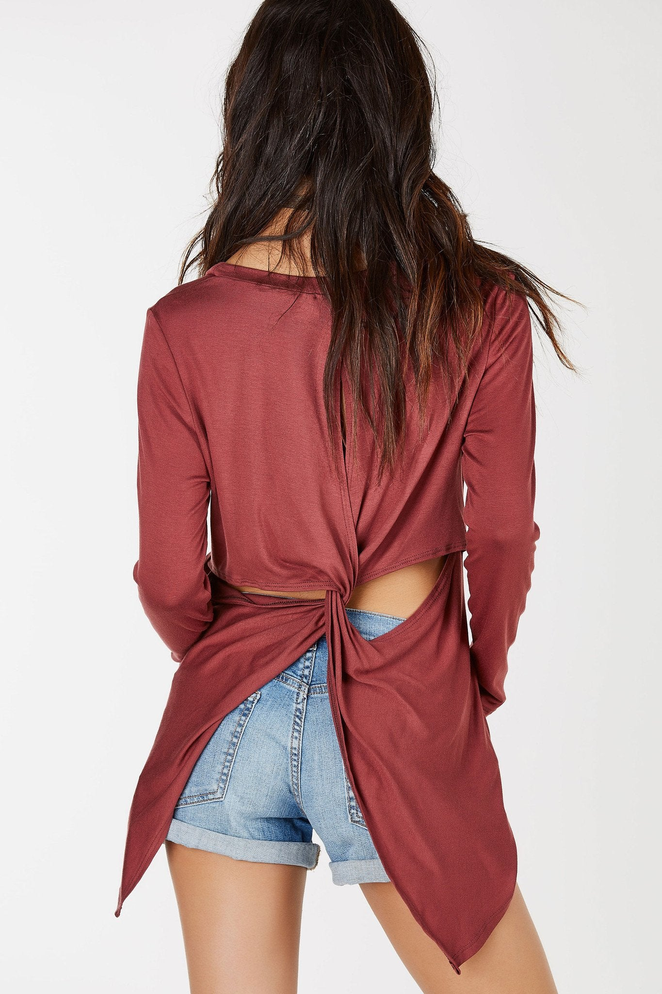 Your basics don't have to be boring! Play up your wardrobe with this classic long sleeve top with a dope cut out back featuring a twist at center to keep things interesting. Lightweight and soft, a perfect layering piece for Fall!