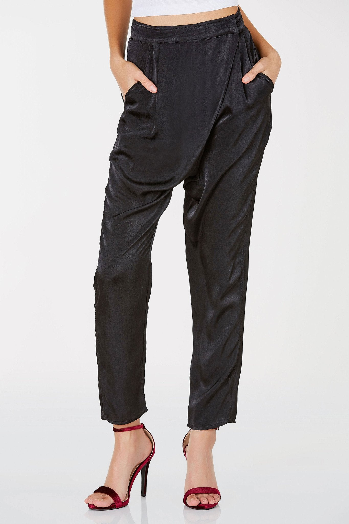 These amazing pair of pants will bring you comfort and style with ease. Chic wrap design in front for closure with a gorgeous satin finish. Super lightweight makes it perfect to style all year round by layering a pair of thermals underneath to combat the cold. Great to work and even special date nights!