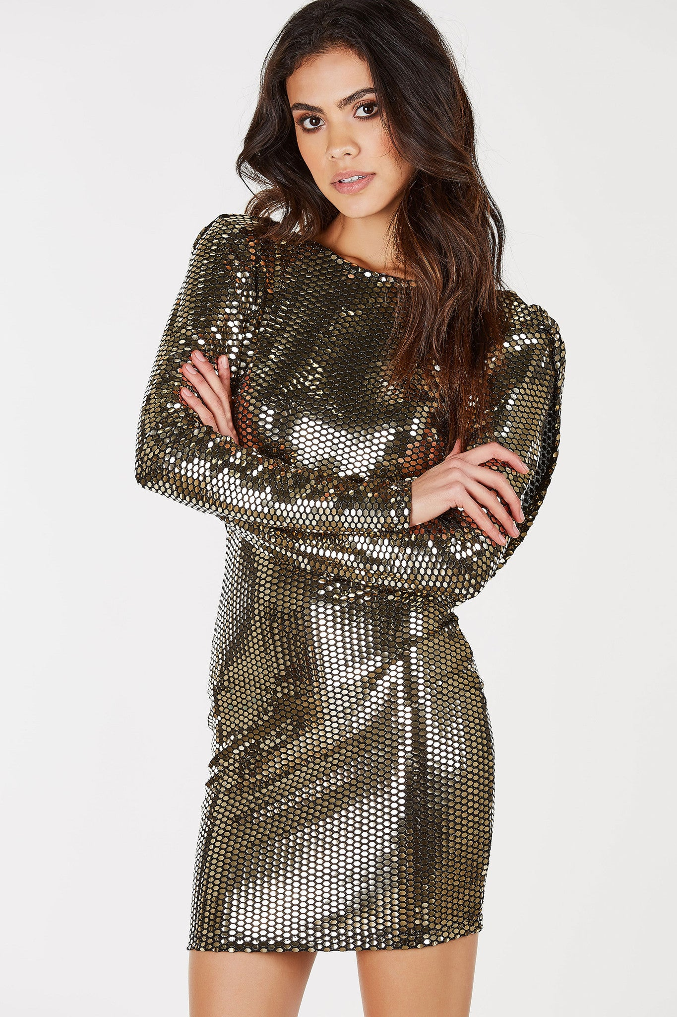 "A definite eye-catcher and conversation starter. This stunning mini dress has an amazinng sequin exterior to make you stand out in any crowd. Long sleeves with an overall flattering fit. Scooped draping back adds an extra ""wow"" factor. Great to special events and parties!"