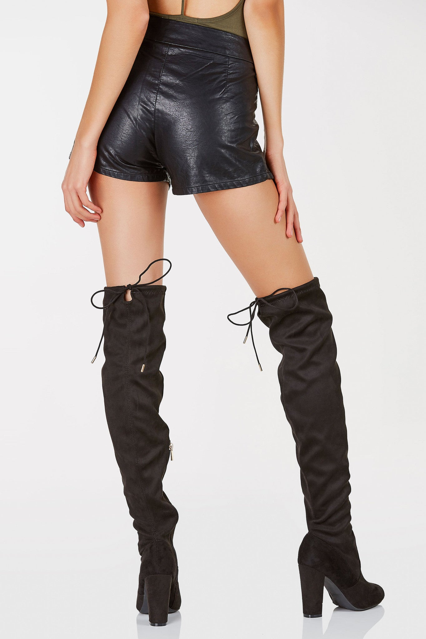 A sick pair of faux leather shorts with trendy lace up detailing in front. Hidden side zip closure for ease. Chic cut out design at hem to flatter your legs. Easy to dress down with a basic tee and sneakers or dress up with a bodysuit and heels!