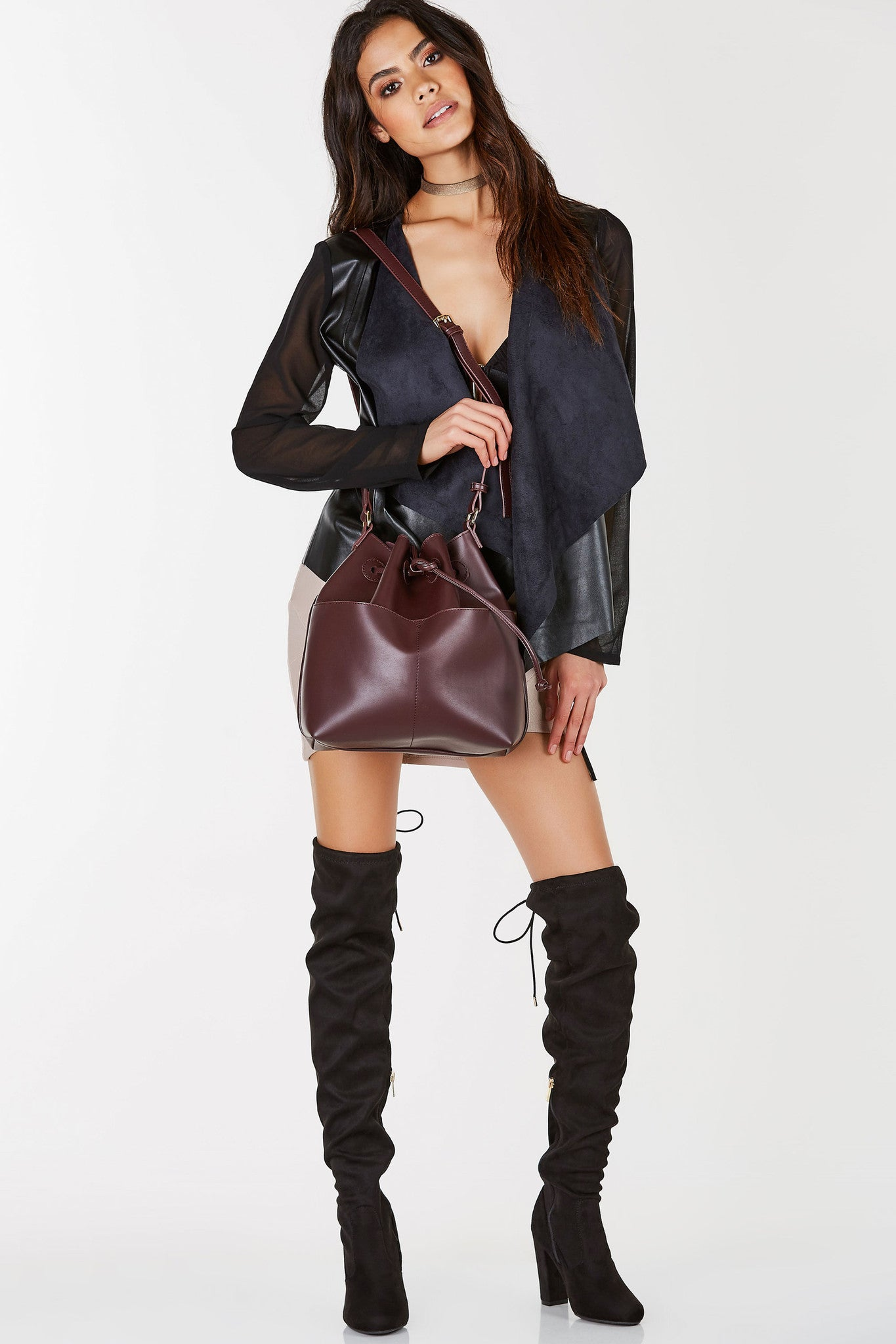 A gorgeous bucket bag with an incredibly chic and smooth faux leather finish. Classic drawstring closure with dual functional pockets in front. Roomy interior to store all your goodies away. Great to style with brunch outfits!