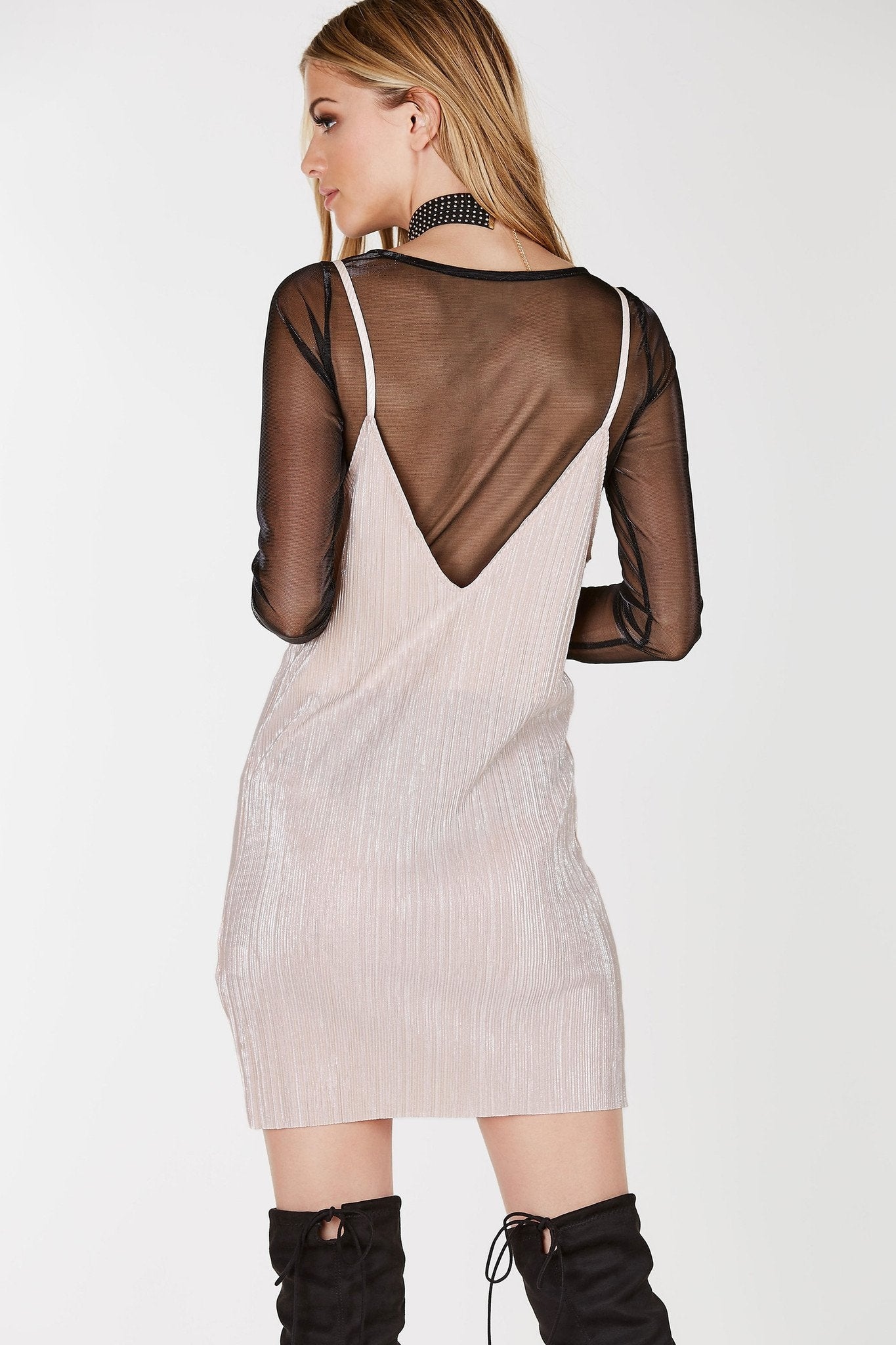 Pleated straight hem with deep V-neckline. Thin shoulder straps with full lining. Foiled finish with hints of silver.