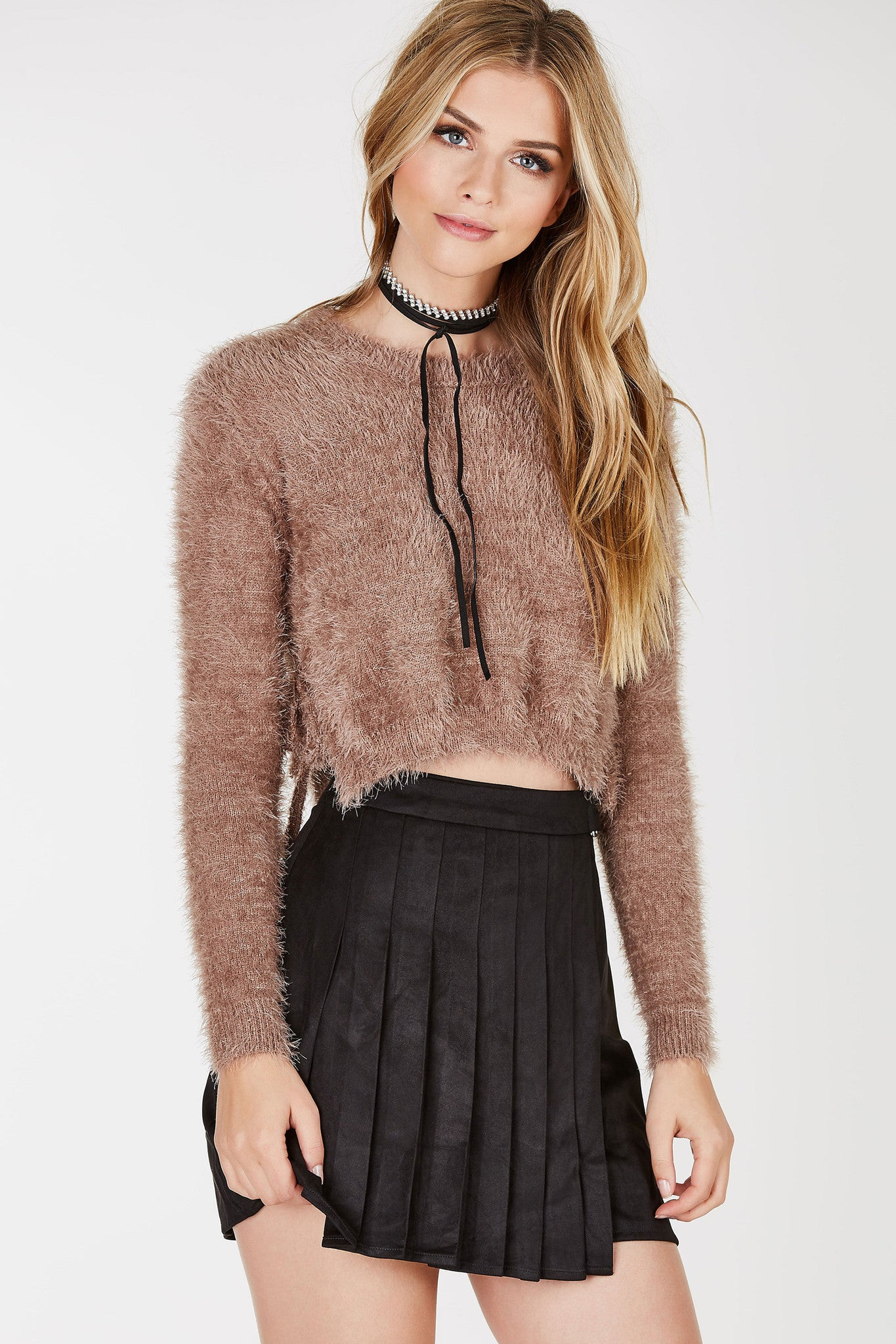 Fuzzy long-sleeved, cropped sweater with side ties that's perfect for fall weather.