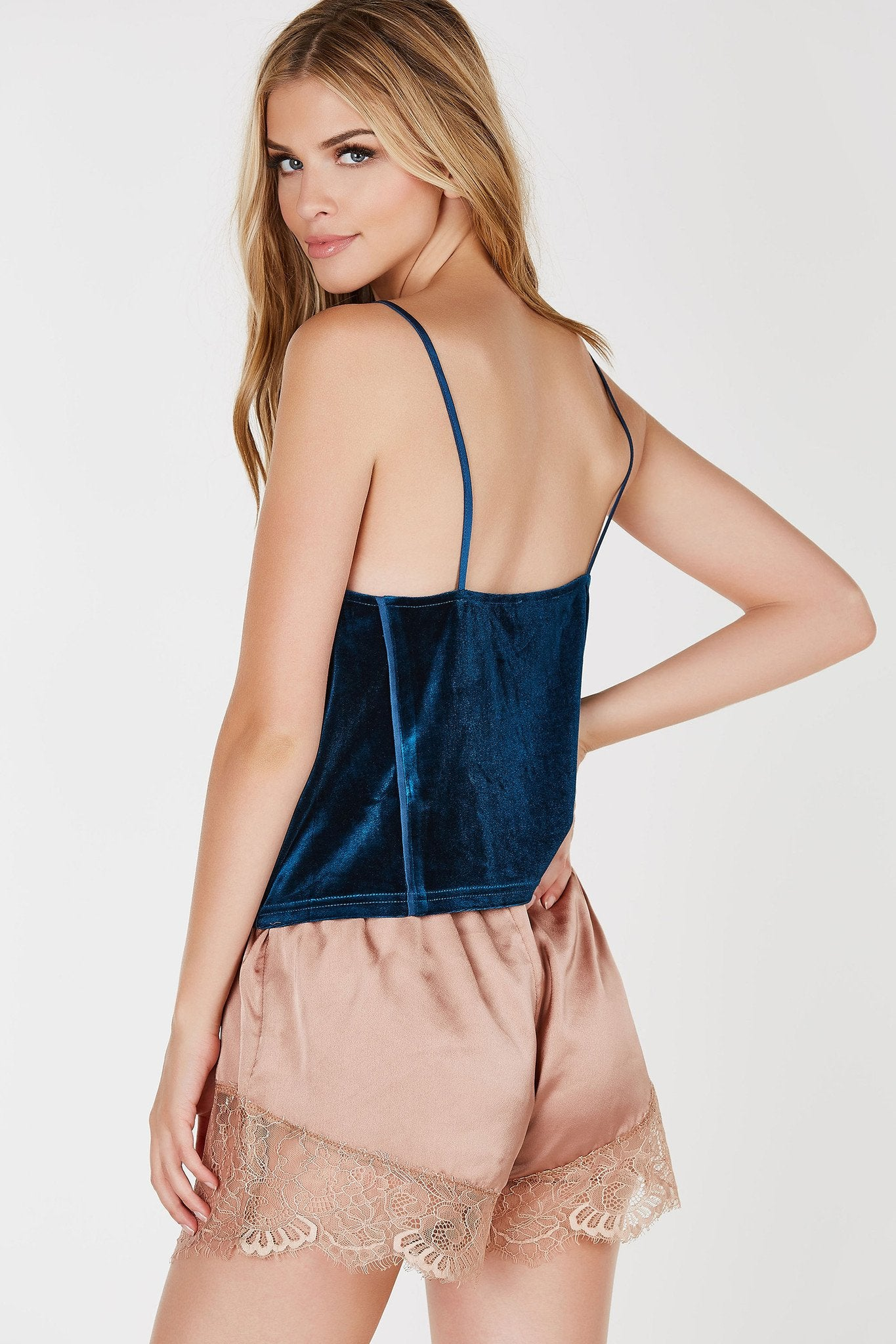 Loose-fitted velvet cami top with V neckline.