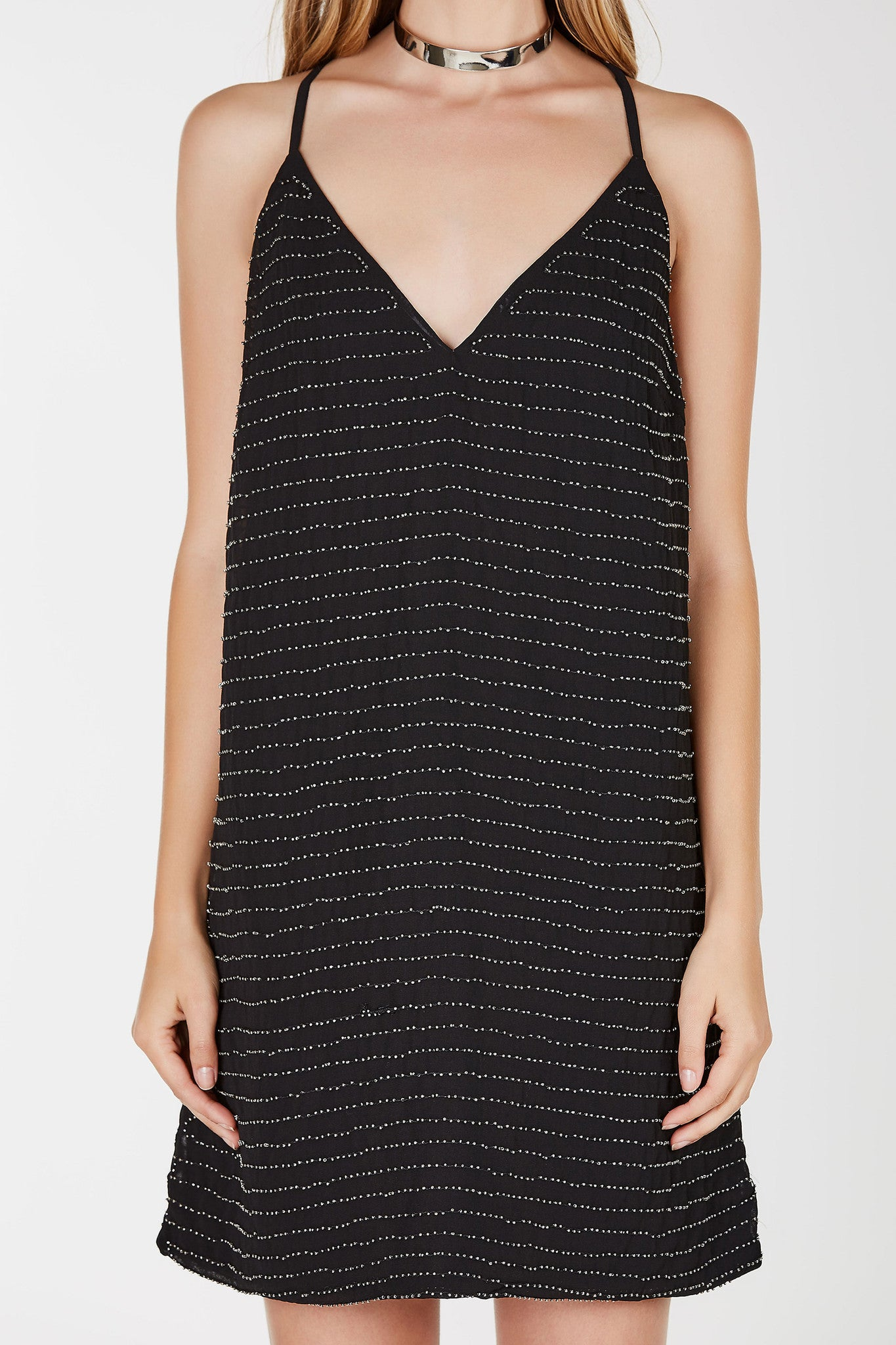 Relaxed fit cmi styled mini dress. Beaded design throughout. V-neckline with Y shaped finish in back.