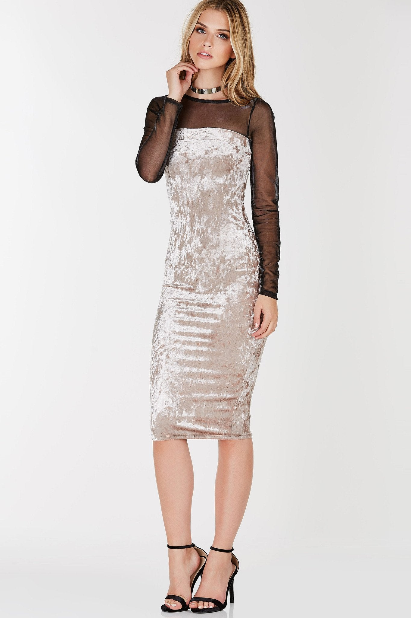 Tube design midi dress with straight hem all around. Textured velvet finish with smooth interior.