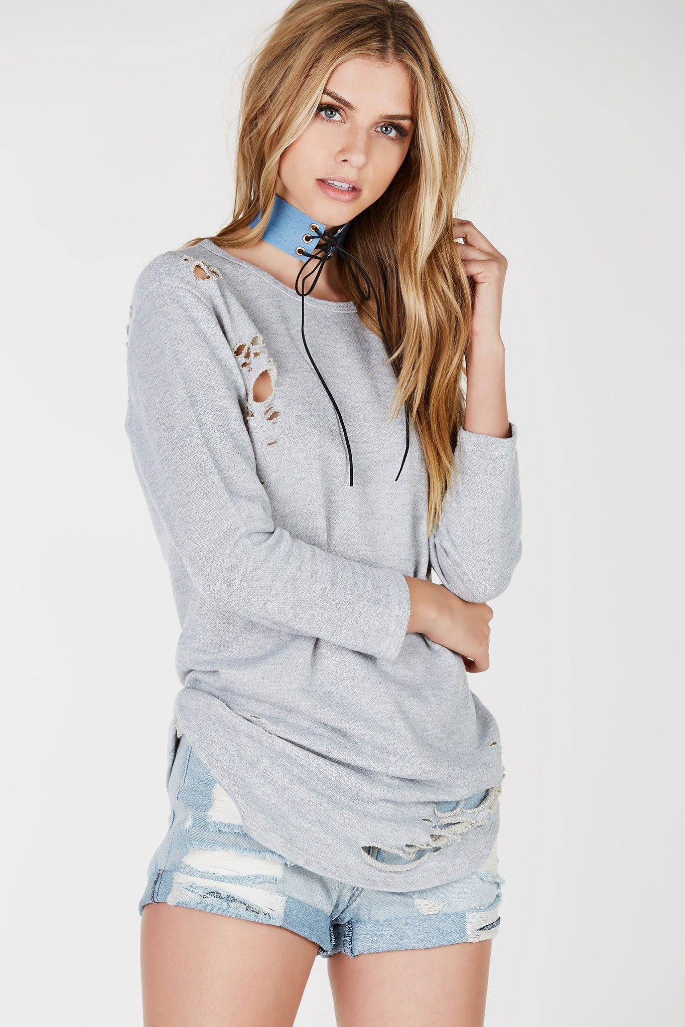 Bring out the street-vibe in you with this dope longling tunic. Trendy distressing throughout with cozy long sleeves. Rounded hi-low hem- perfect to style as a dress with an oversized denim jacket.