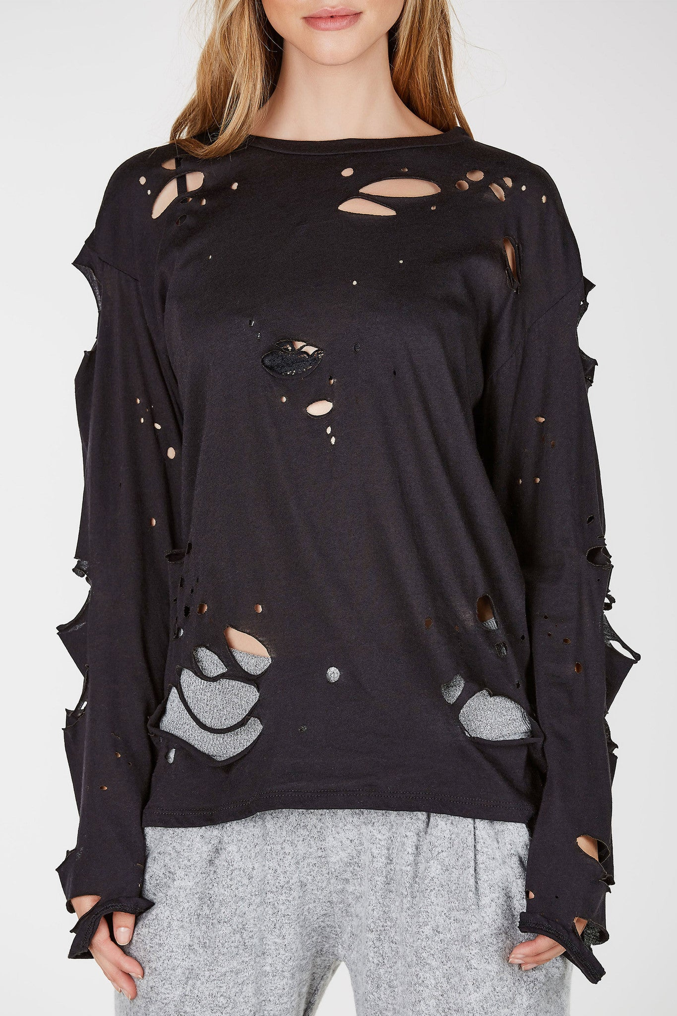 Oversized and distressed long-sleeved top. This crewneck top will add some edge to your fall wardrobe.