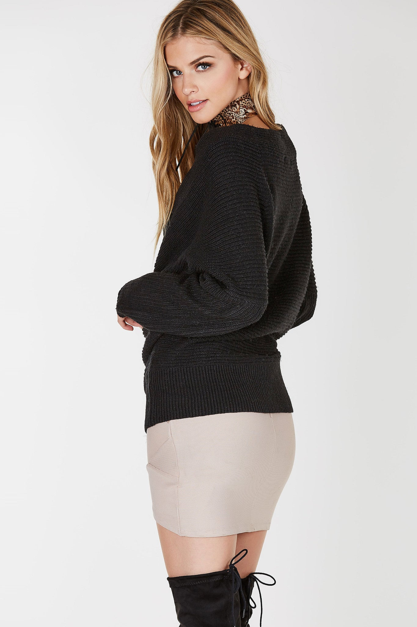 Long sleeve tight knit sweater with draped open front. Relaxed fit with straight hem all around.
