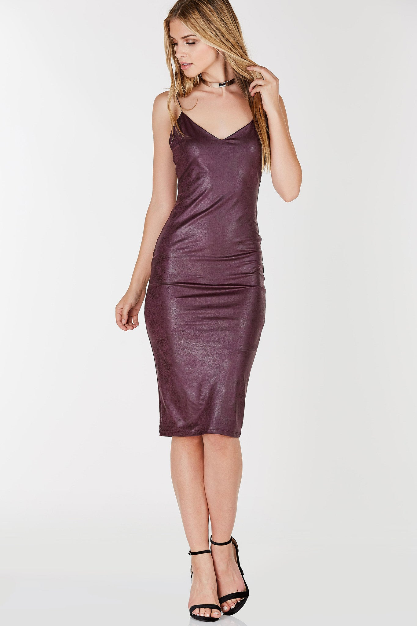 Fully lined with straight hem. V-neckline and cord shoulder straps. Bodycon fit with faux leather finish.