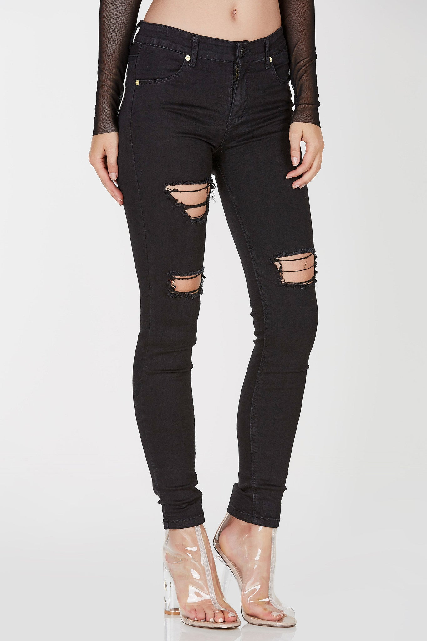 Stretchy skinny jeans with high rise waist. Distressed in front with four functional pockets.