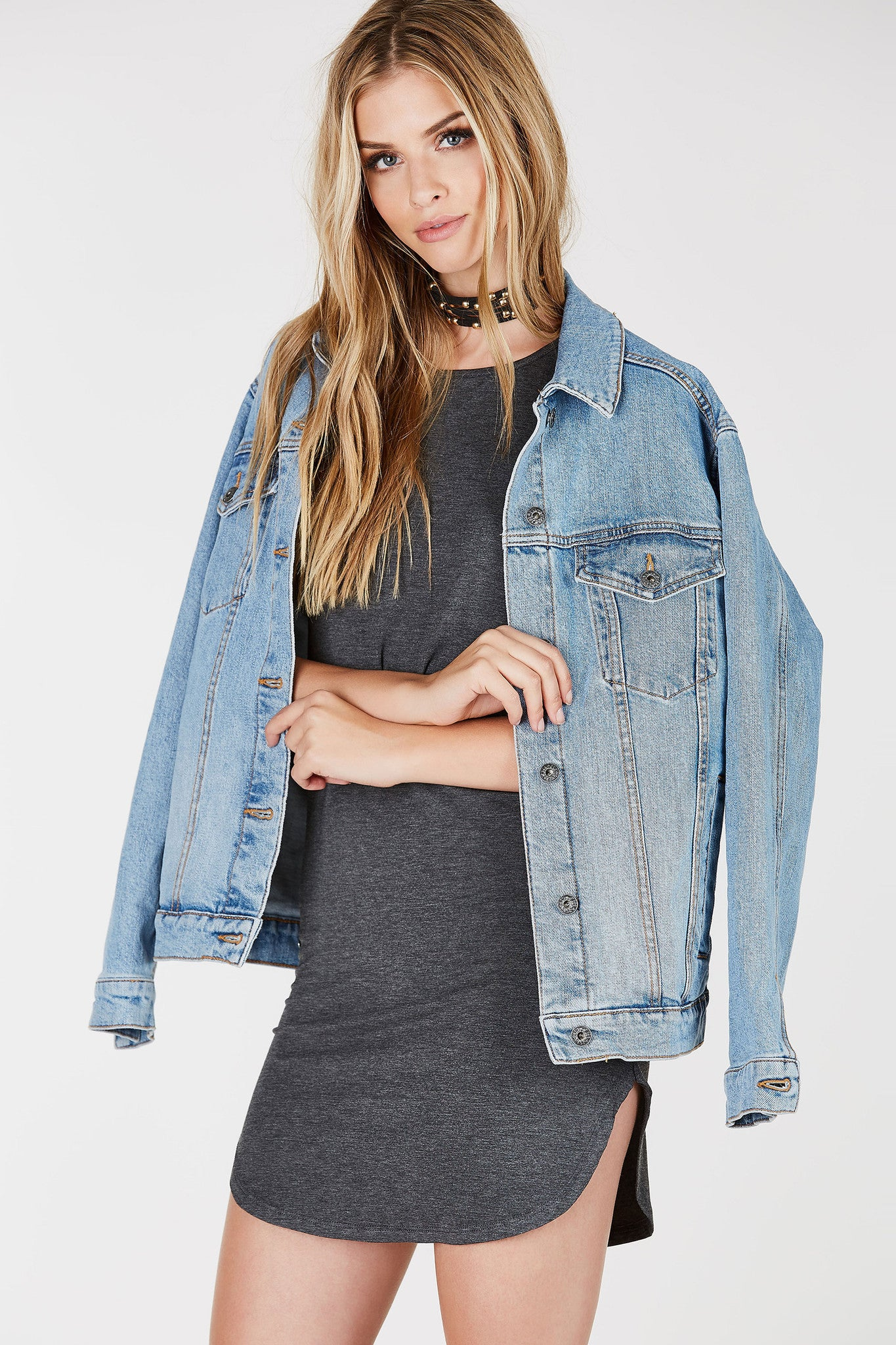 A basic mini dress, a staple piece for your wardrobe. Soft comfortable material with clean cut short sleeves. Rounded neckline to match the hem. Style with sneakers and a jean jacket for a casual street-style outfit.