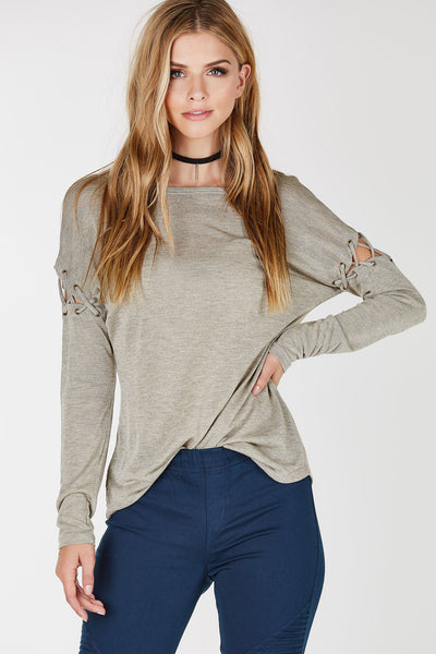 Lightweight long sleeve top with rounded neck and hemline. Cold shoulder cut outs with lace up detailing.