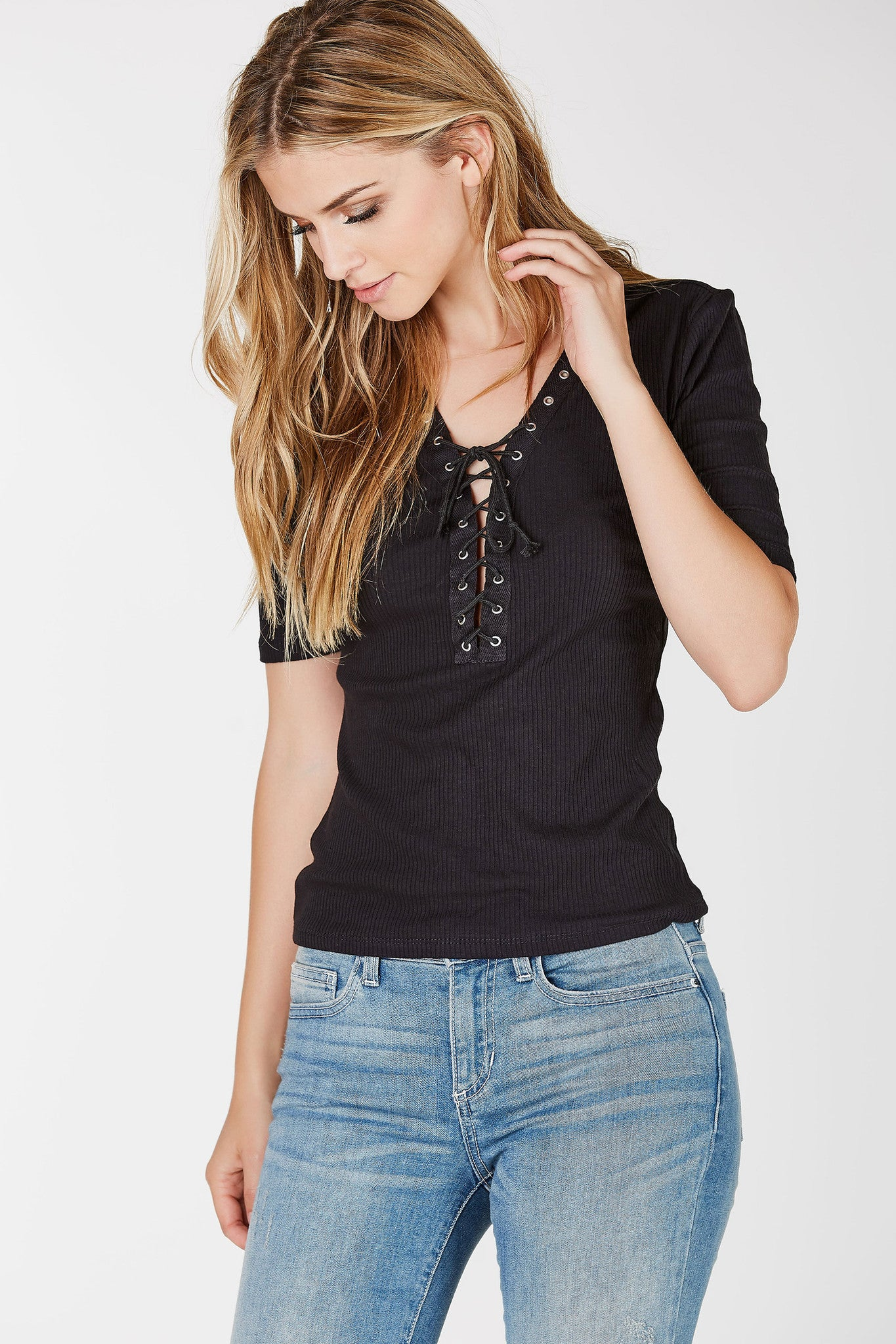 V-neck ribbed tee with short sleeves. Lace up design with eyelet detailing.
