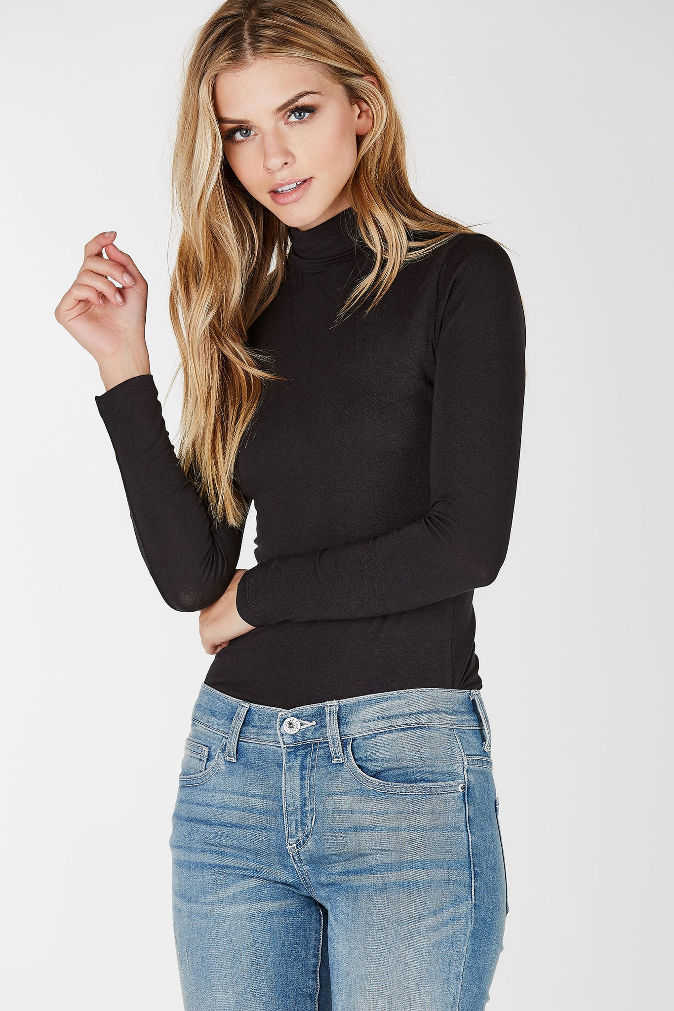 Lightweight, stretchy long sleeve top with slim body hugging fit. Long fitted sleeves with straight hem all around.