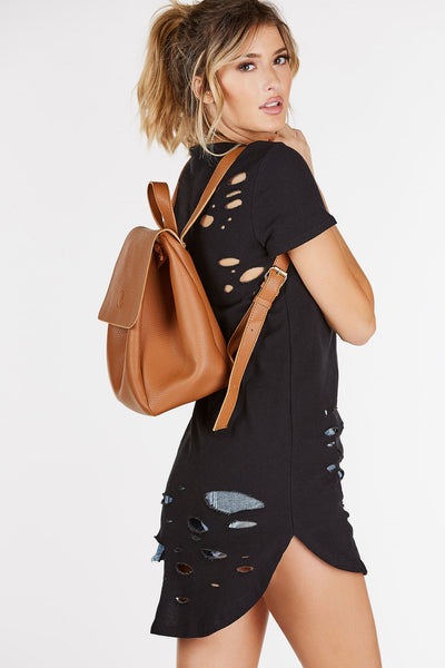 A trendy faux leather backpack perfect for school or a casual day out. Roomy body to carry all of your belongings with classic adjustable shoulder straps. Flap over design with magnetic closure with drawstring finish.
