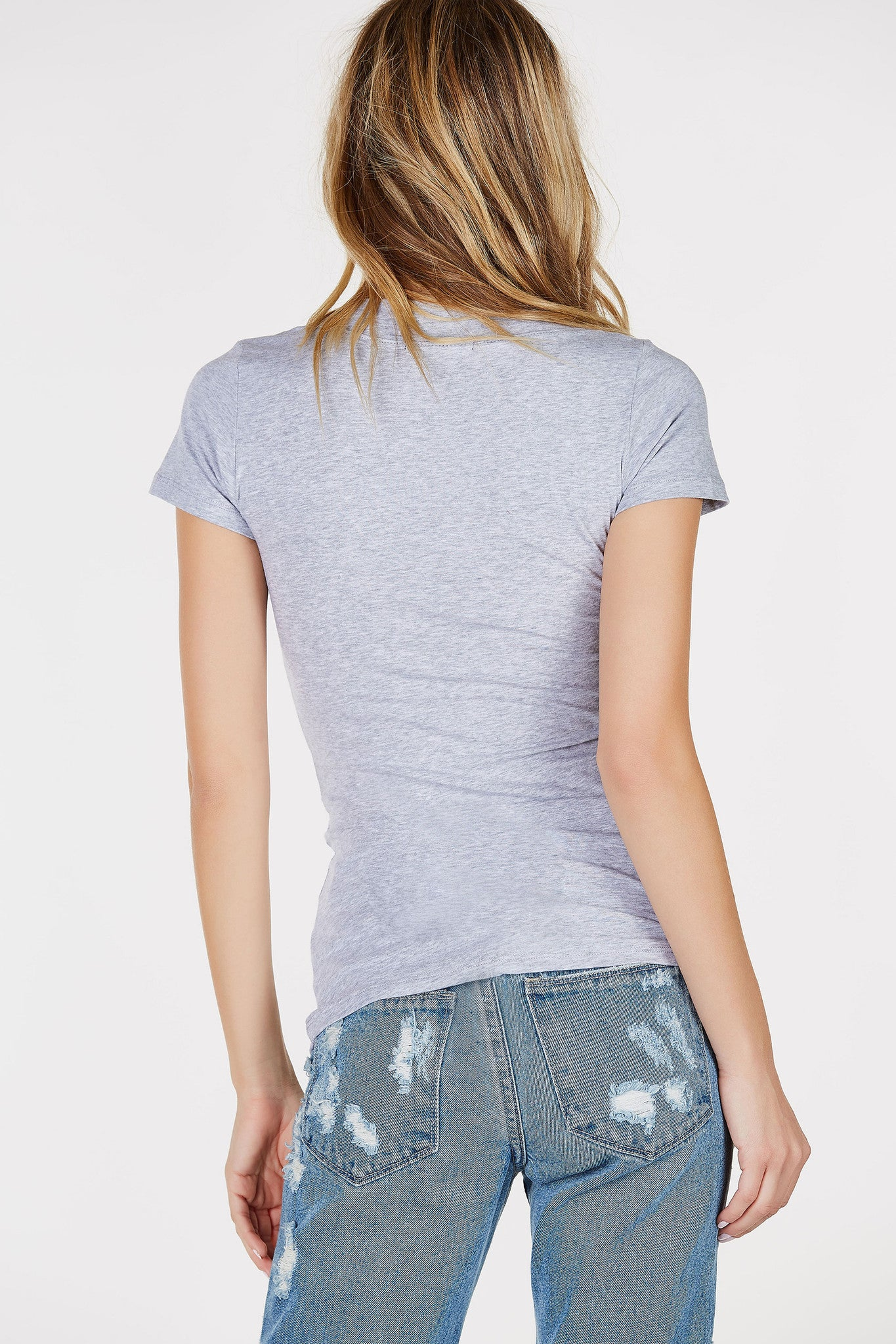 Super soft basic v-neck tee. Perfect for sporting on the daily. Lightweight and thin--great for layering.