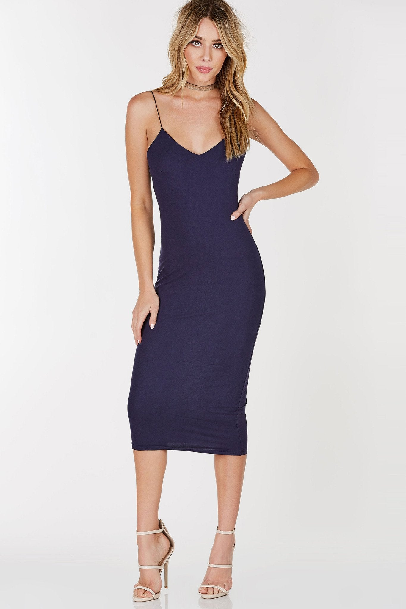An elegant midi dress with beautiful suede-like exterior. Spaghetti straps with a flattering V neckline. Lined inside for a comfortable wear and extra coverage. Great to pair with strappy pumps!