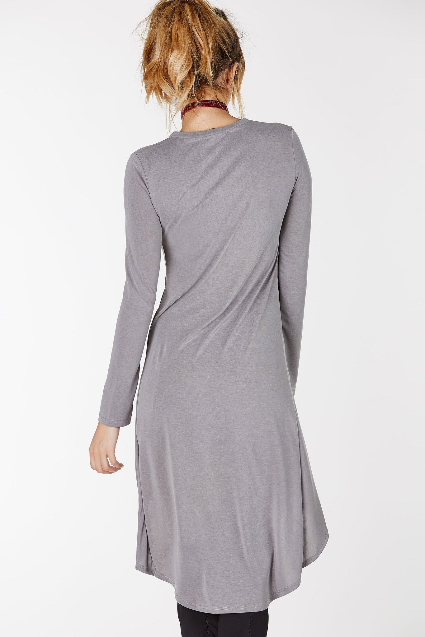 Crew neckline long sleeve maxi top with hi-low hem and knot detailing at center.