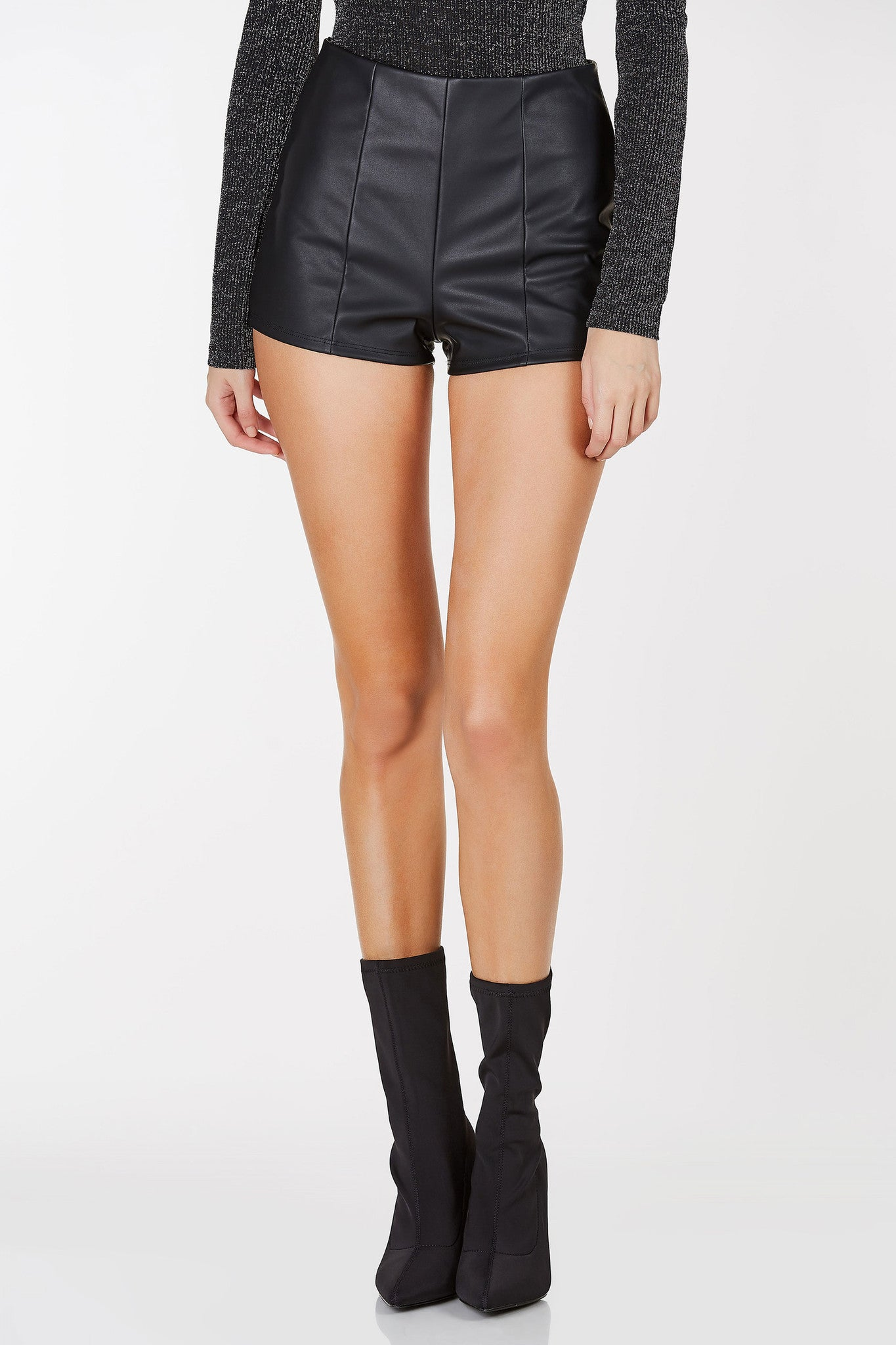 Pleather shorts with double center panels. Invisible back zipper closure.